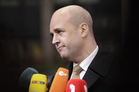 Sweden's Prime Minister Fredrik Reinfeldt arrives for an EU summit in Brussels on Monday, Jan. 30, 2012. European leaders will try to come up with ways to boost growth despite steep budget cuts across the continent when they meet in Brussels on Monday. The 27 heads of state and government will get a taste of the popular frustration with austerity and high unemployment as they try to get to the summit in a city paralyzed by strikes. (AP Photo/Frank Augstein