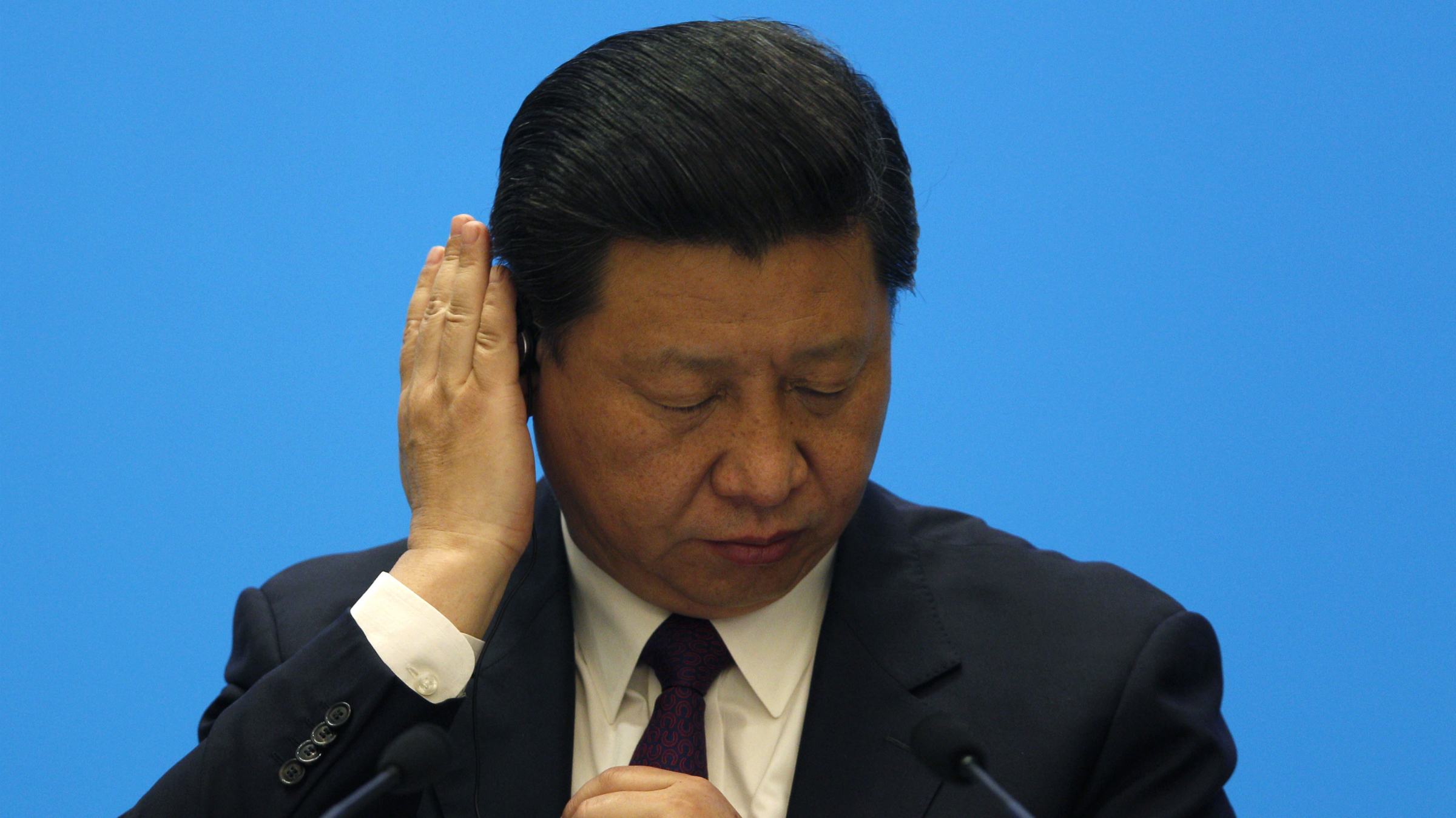 China's President Xi Jinping reacts during a meeting with representatives of entrepreneurs at the annual Boao Forum in Boao, in southern China's Hainan province, Monday, April 8, 2013. (AP Photo/Tyrone Siu, Pool