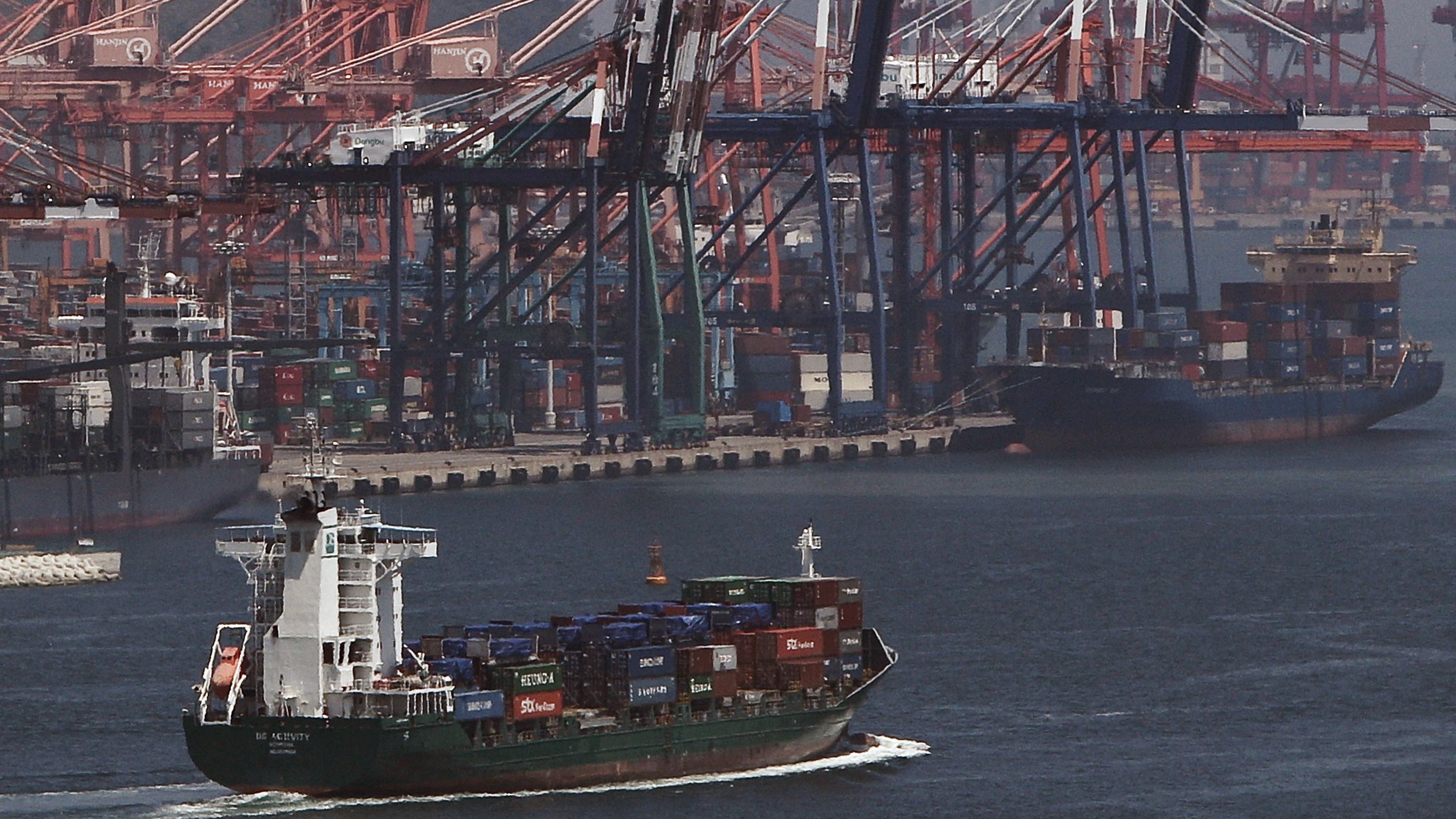 A container ship passes by a port in Busan, South Korea Thursday, June 3, 2010. Finance officials from leading advanced and emerging countries began talks Thursday aimed at hammering out reforms to the global economic system to prevent debilitating crises such as the one that dragged the world to the verge of a depression in 2008. (AP Photo/Andy Wong)