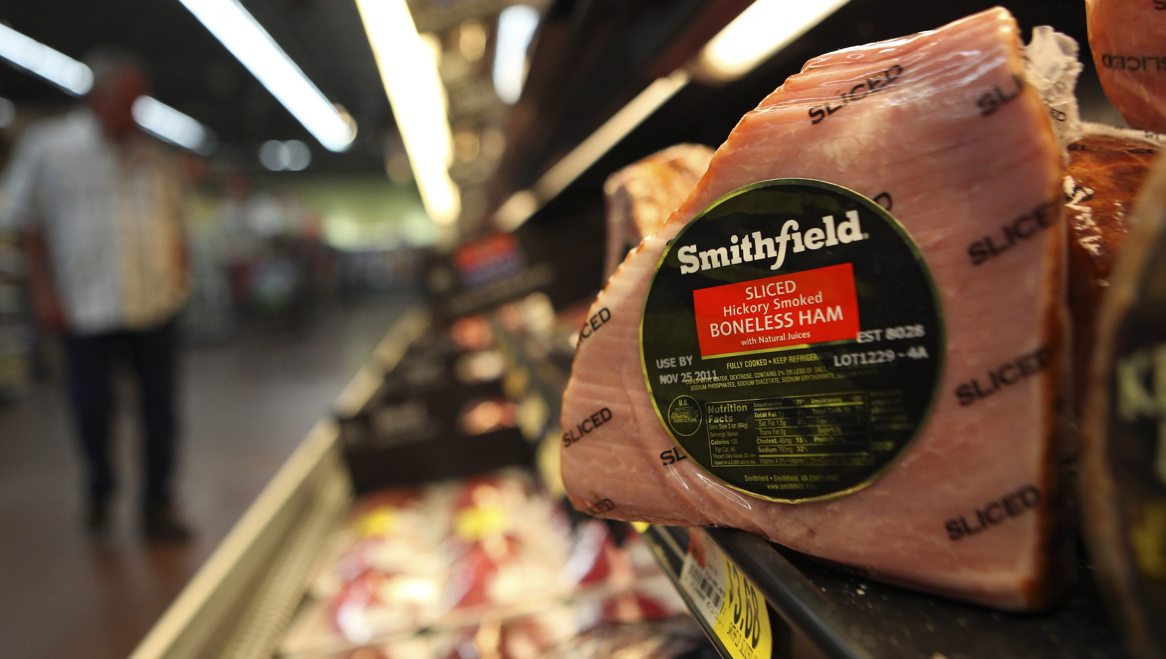 FILE - This Sept. 6, 2011 file photo shows a Smithfield ham at a grocery store in Richardson, Texas. Smithfield Foods Inc. reports its fiscal quarter net income on March 7, 2013. (AP Photo/LM Otero)