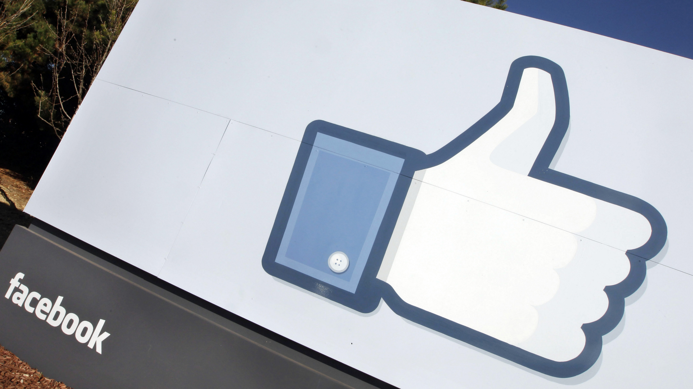 """A Jan. 12, 2012 file photo, shows the Facebook """"like"""" icon displayed outside of Facebook's headquarters in Menlo Park, Calif. The """"like"""" button on Facebook seems like a relatively clear way to express your support for something, but a federal judge says that doesn't mean clicking it is constitutionally protected speech. (AP Photo/Paul Sakuma)"""