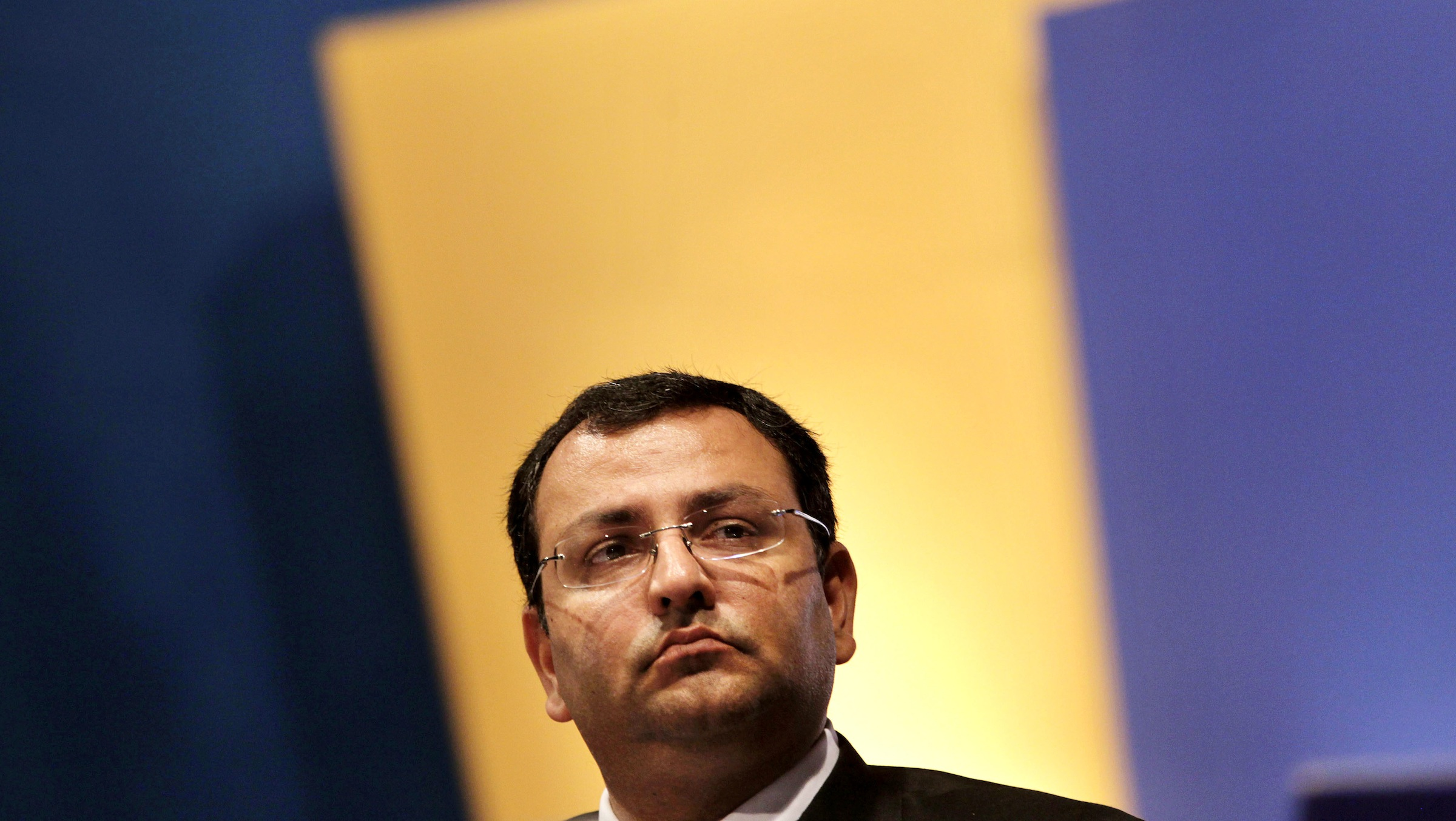 Tata Sons Deputy Chairman Cyrus Mistry watches during Tata Consultancy Services annual general meeting in Mumbai, India, Friday, June 29, 2012. (AP Photo/Rajanish Kakade)