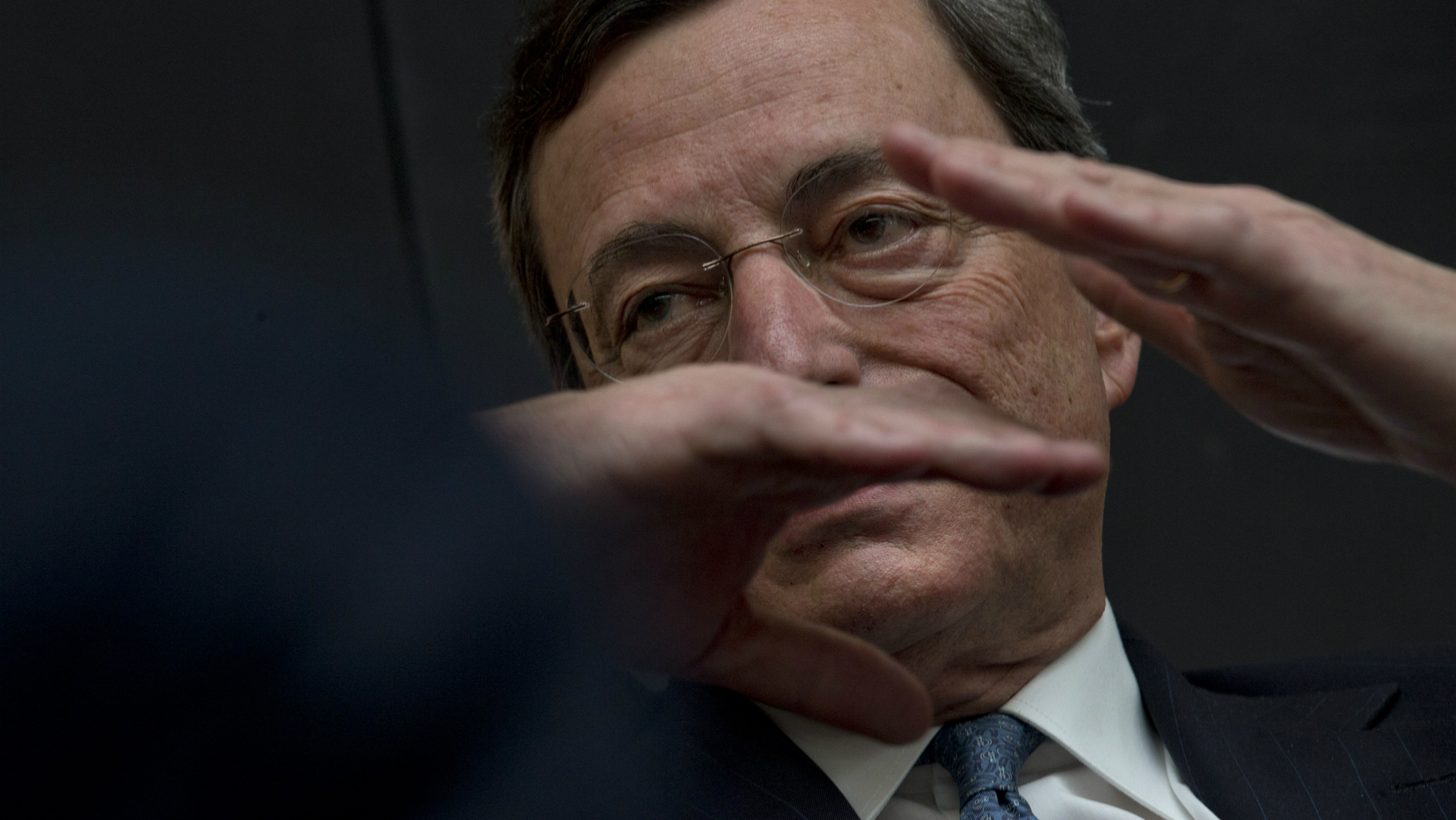 "European Central Bank President Mario Draghi gestures when answering questions of students during a session of ""Room for Discussion"" at the Faculty of Economics of the UvA, or University of Amsterdam, Netherlands, Monday April 15, 2013. (AP Photo/Peter Dejong)"
