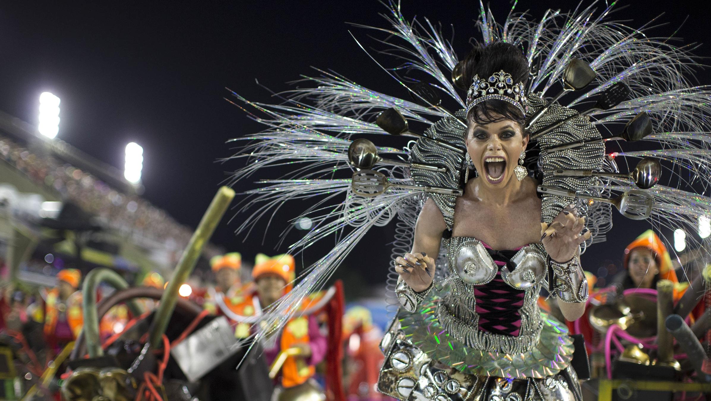 A performer from the Sao Clemente samba school parades during carnival celebrations at the Sambadrome in Rio de Janeiro, Brazil, Monday, Feb. 11, 2013. (AP Photo/Felipe Dana)