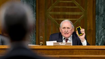 Senate Homeland Security and Governmental Affairs Permanent subcommittee on Investigations Chairman Sen. Carl Levin, D-Mich., holds up his own Apple iPhone, on Capitol Hill in Washington, Tuesday, May 21, 2013, as he presses Apple CEO Tim Cook, left, for answers about how Apple, the world's most valuable company, and based in Cupertino, Calif., diverts a billion dollars to an Irish subsidiary as a tax strategy, according to a report issued this week by the subcommittee.