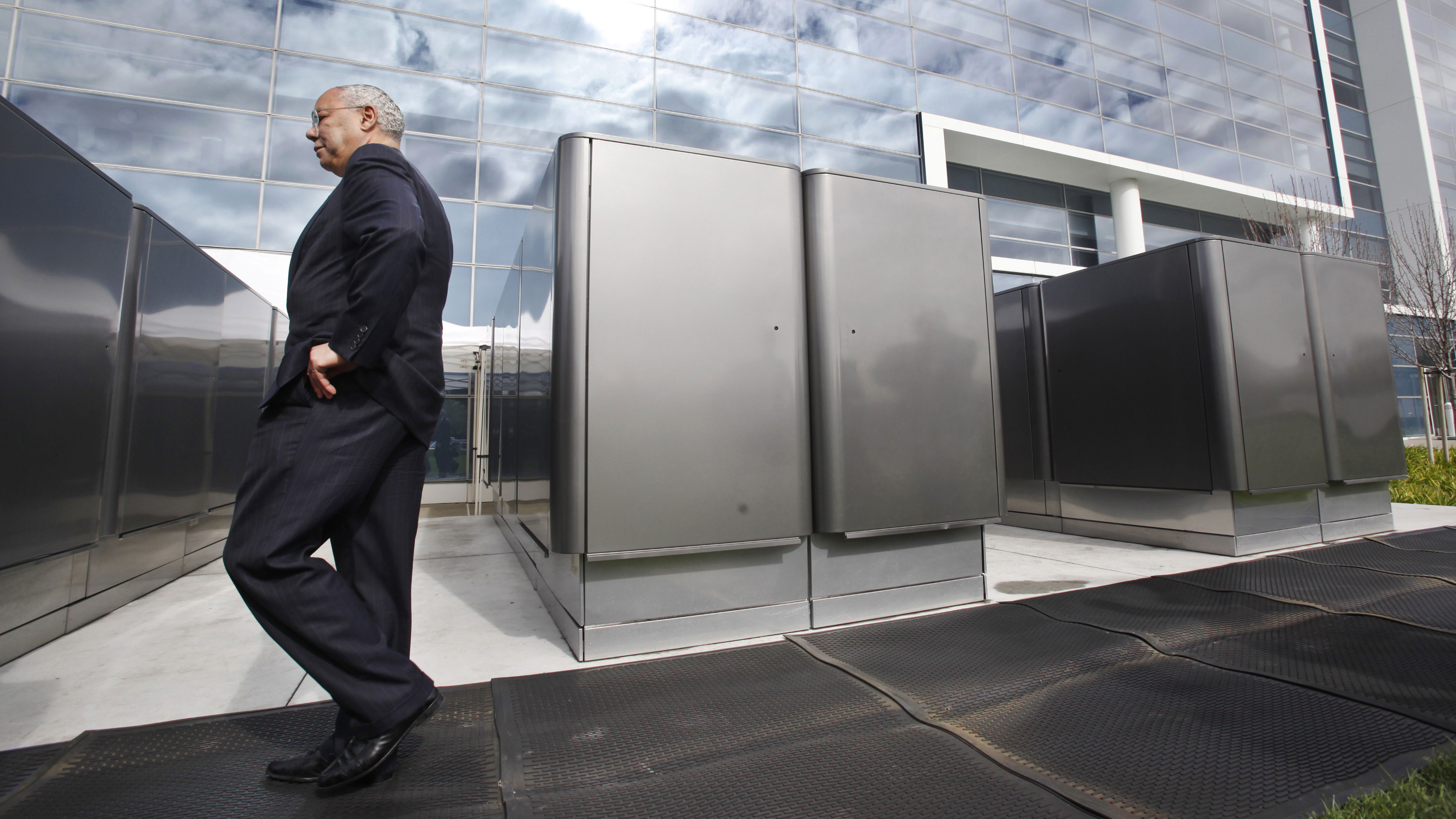 Former Sec. of State Gen. Colin Powell, who serves on the board of Bloom Energy, looks at the Bloom Energy power server at eBay offices in San Jose, Calif., Wednesday, Feb. 24, 2010. Bloom Energy is a secretive Silicon Valley startup that is working on a new way to produce cleaner energy. Its first product is a huge box of fuel cells that it hopes will allow homes and businesses to generate their own electricity. (AP Photo/Paul Sakuma)