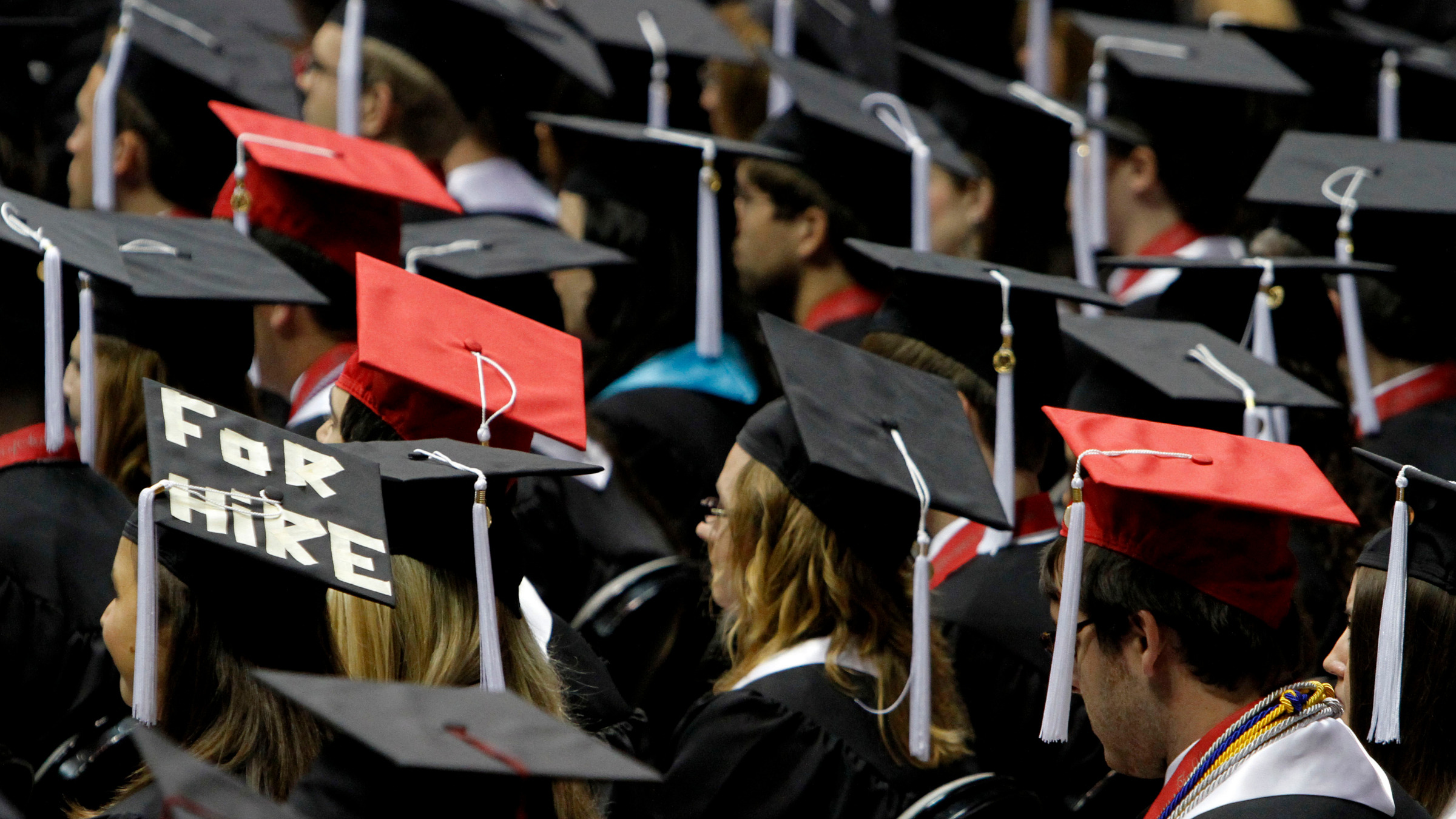 Students at college graduation ceremony.