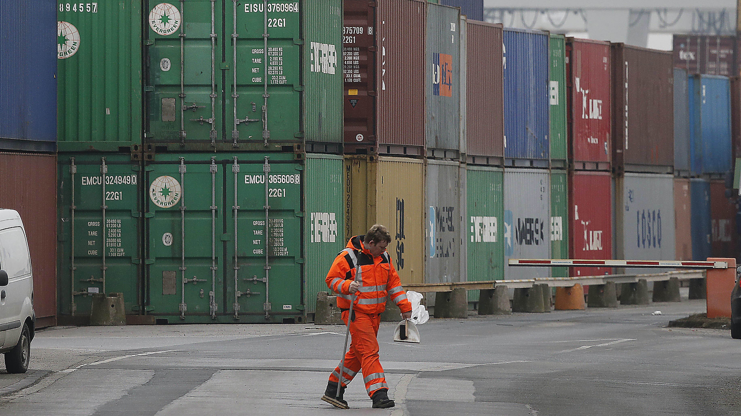 Containers are piled up at the Duisburg harbour, Germany, Thursday, Feb. 14, 2013. The German economy shrank by a larger-than-expected 0.6 percent in the final quarter in 2012, official figures showed Thursday, Feb. 14, 2013, in a clear sign that the European financial crisis took its toll on the continent's largest economy. The quarterly decline was primarily due to a drop in exports as demand weakened from other European nations, many of which are in recession, the Federal Statistical Office said. (AP Photo/Frank Augstein