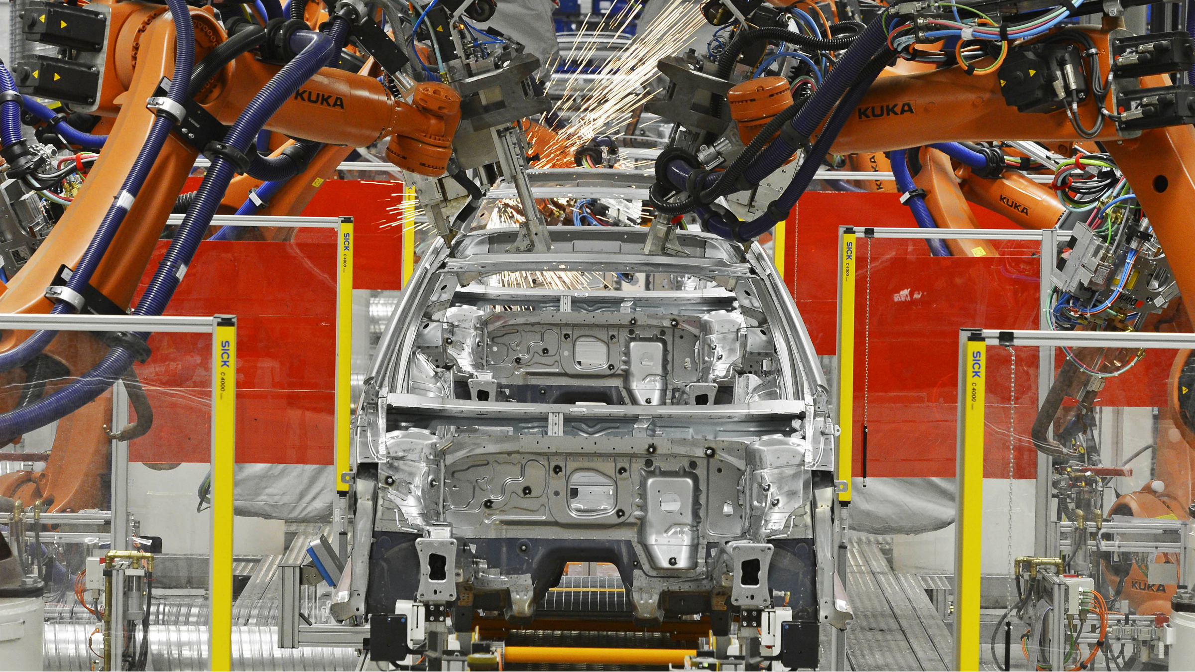 Robots weld Golf car bodies (Golf VII) during a press tour at the plant of the German manufacturer Volkswagen AG (VW) in Zwickau, central Germany, Friday, Nov. 9, 2012. More than 4 million vehicles (Golf and Passat) have left the production facilities since foundation of the Zwickau plant in 1990. (AP Photo/Jens Meyer