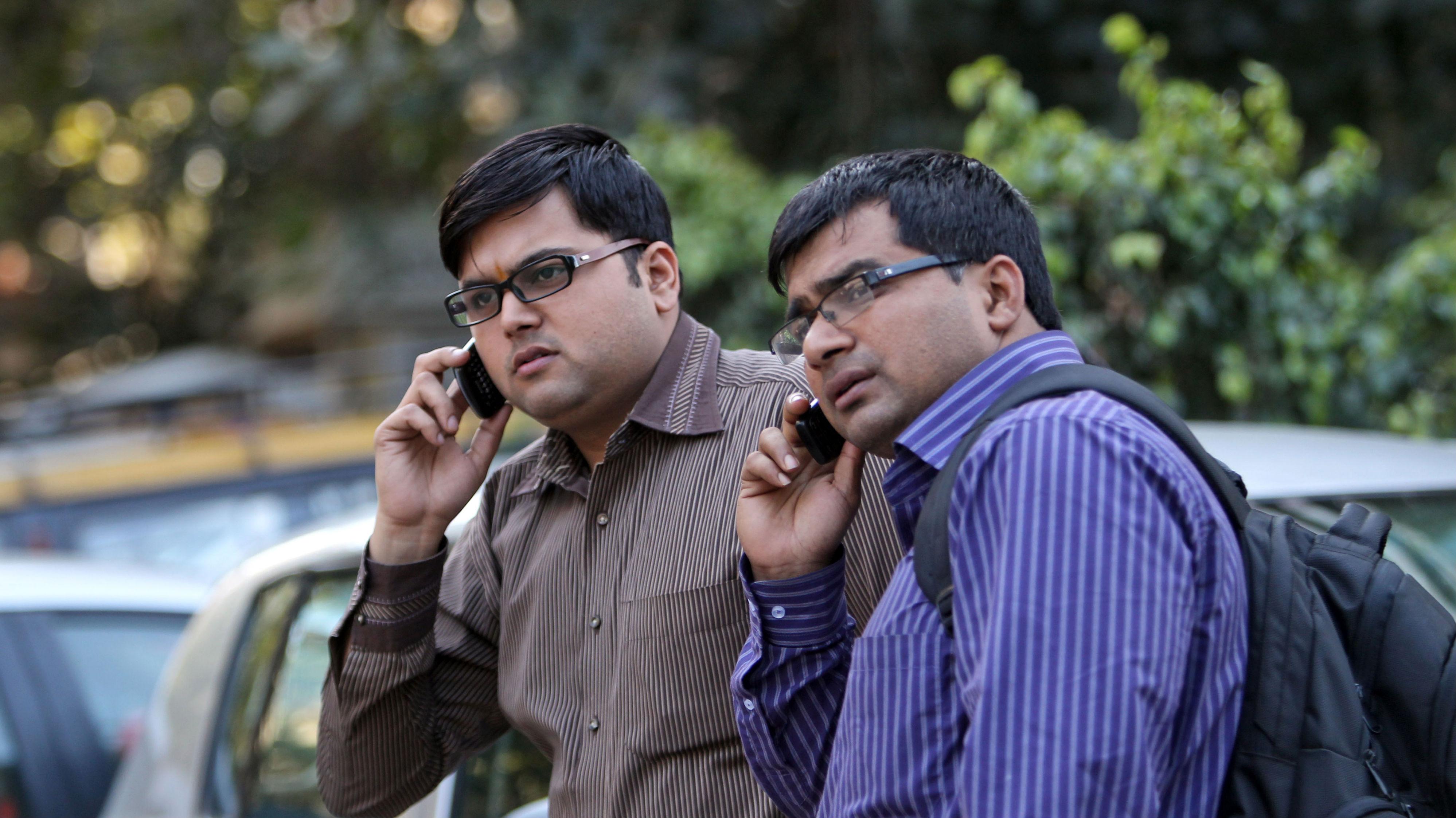 indian men on phones