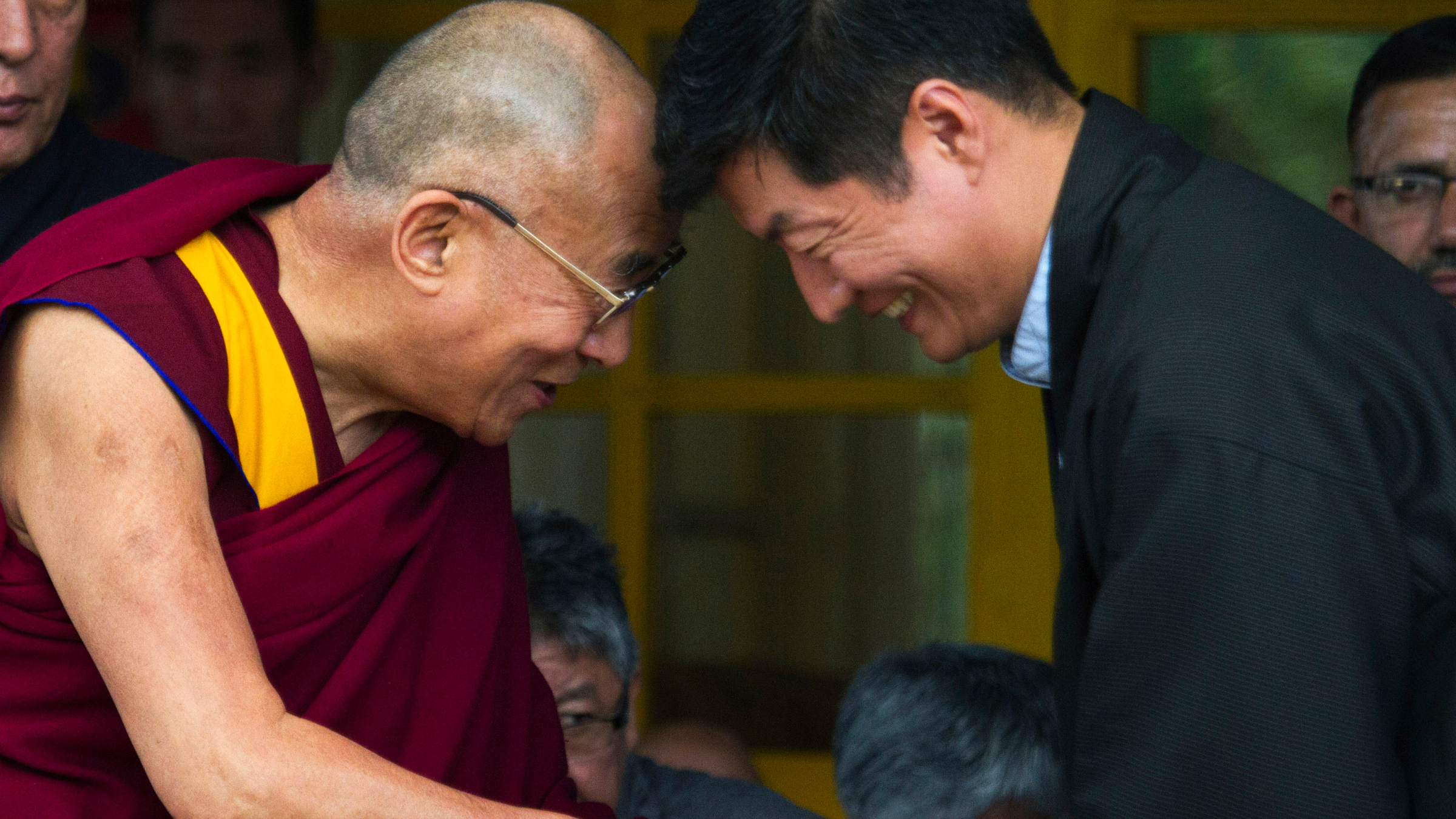 Tibetan spiritual leader the Dalai Lama, greets Lobsang Sangay, the prime minister of the Tibetan government-in-exile.