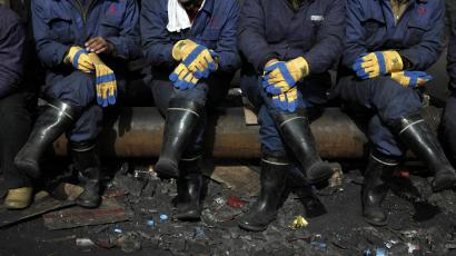 Rescue workers are on standby outside the shaft of the Wangjialing Coal Mine in Xiangning county in north China's Shanxi province, Sunday, April 4, 2010. Search and rescue continue almost a week after water flooded a mine, trapping 153 miners. (AP Photo/Ng Han Guan