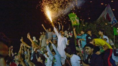 Nawaz Sharif's Muslim League-N party celebrate victory in Lahore on Sunday.