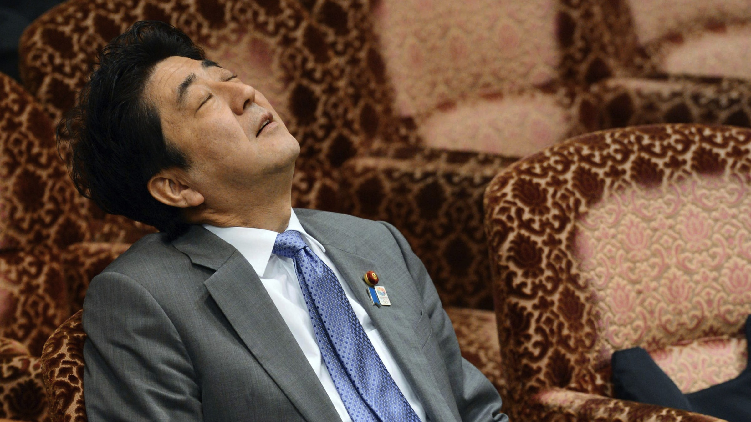 Japan's Prime Minister Shinzo Abe waits for the start of the Upper House Budget Committee in Tokyo Wednesday, May 8, 2013.  (AP Photo/Kyodo News) JAPAN OUT, MANDATORY CREDIT