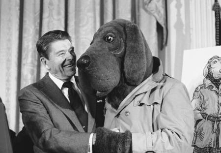 "President Ronald Reagan meets ""McGruff"" the crime dog, during Crime Prevention Week ceremonies at the White House in Washington, Feb. 15, 1984. Sergeant Winston Cavendish of the St. Tammany's Parish Sheriff Department put on the ""McGruff"" outfit to take part in the ceremony that recognized elected officials, law enforcement officers and citizen volunteers. (AP Photo/Barry Thumma)"