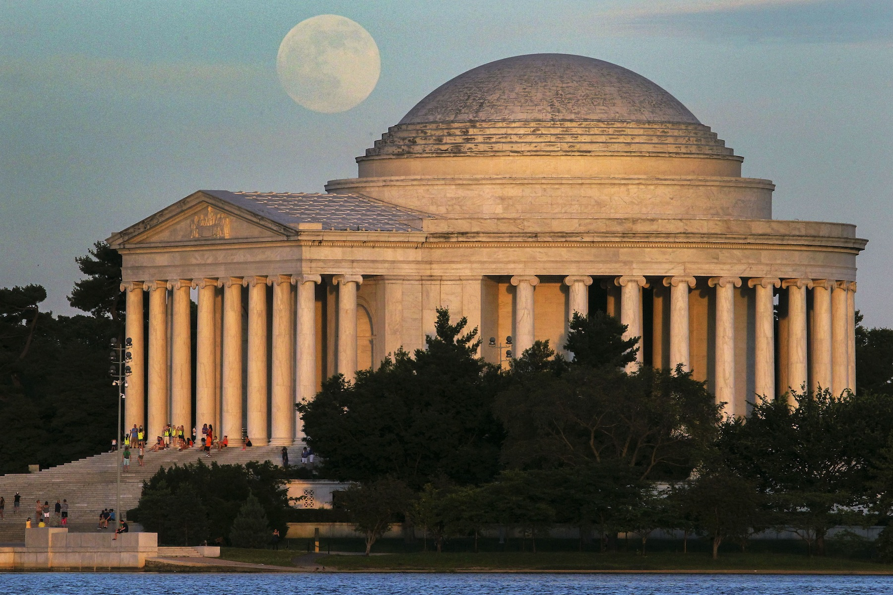 """A full moon rises behind the Jefferson Memorial in Washington Saturday, June 22, 2013. The larger than normal moon called the """"Supermoon"""" happens only once this year as the moon on its elliptical orbit is at its closest point to earth. (AP Photo/J. David Ake)"""