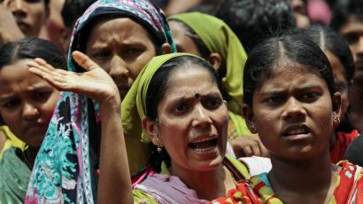 Bangladeshi garment industry workers rally on the streets demanding better conditions.