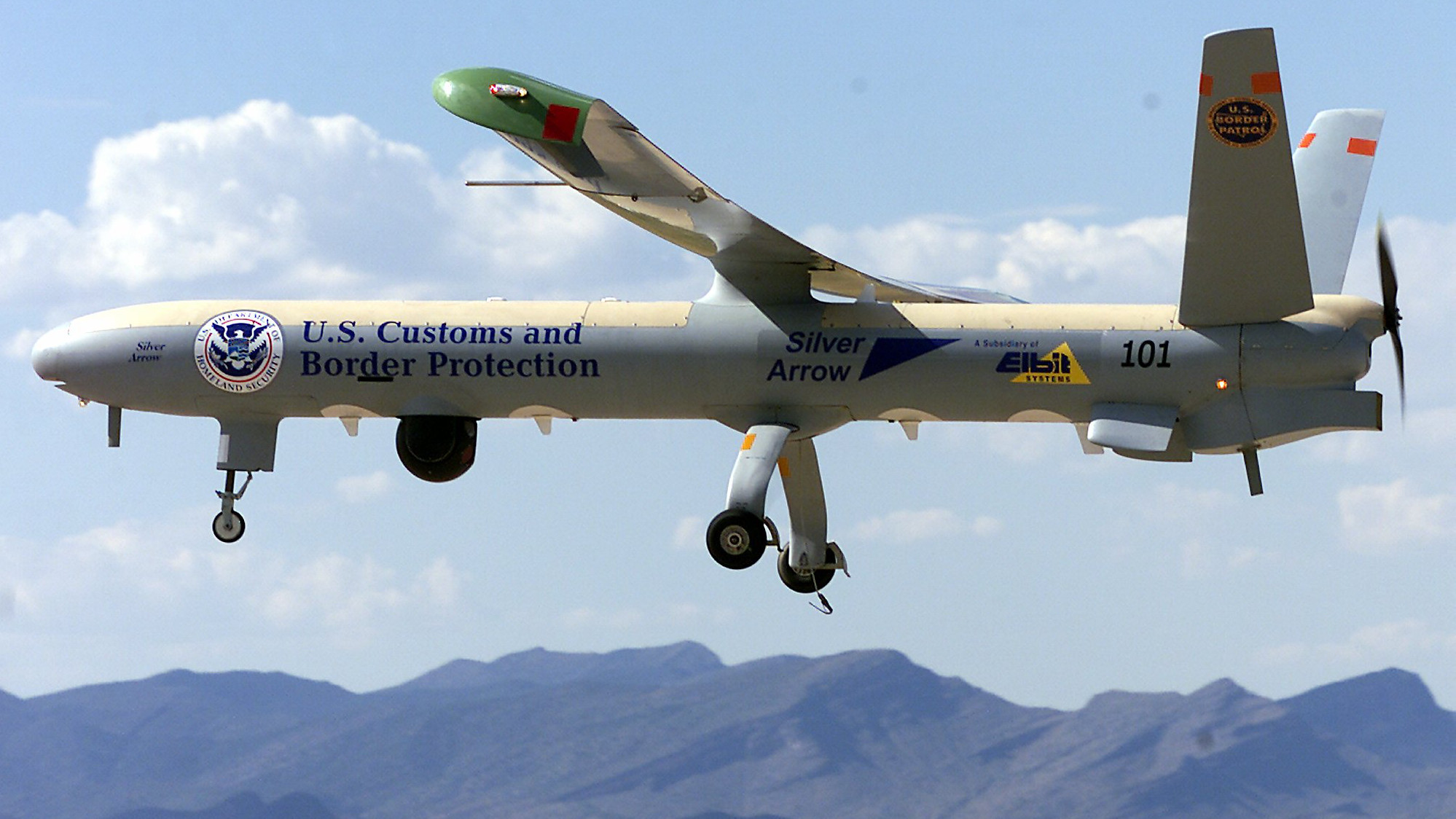 The U.S. Border Patrol's new unmanned-aerial-vehicle or UAV is shown in flight at Fort Huachuca, Ariz., Friday, June 25, 2004. The unmanned drone, launched by the Border Patrol on Friday, uses thermal and night-vision equipment to help agents spot illegal immigrants trying to cross the desert into the United States.