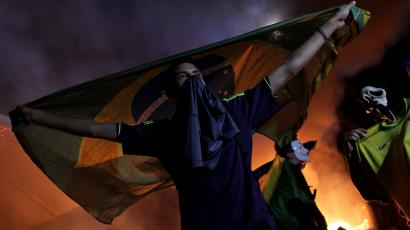 Brazil protester with flag
