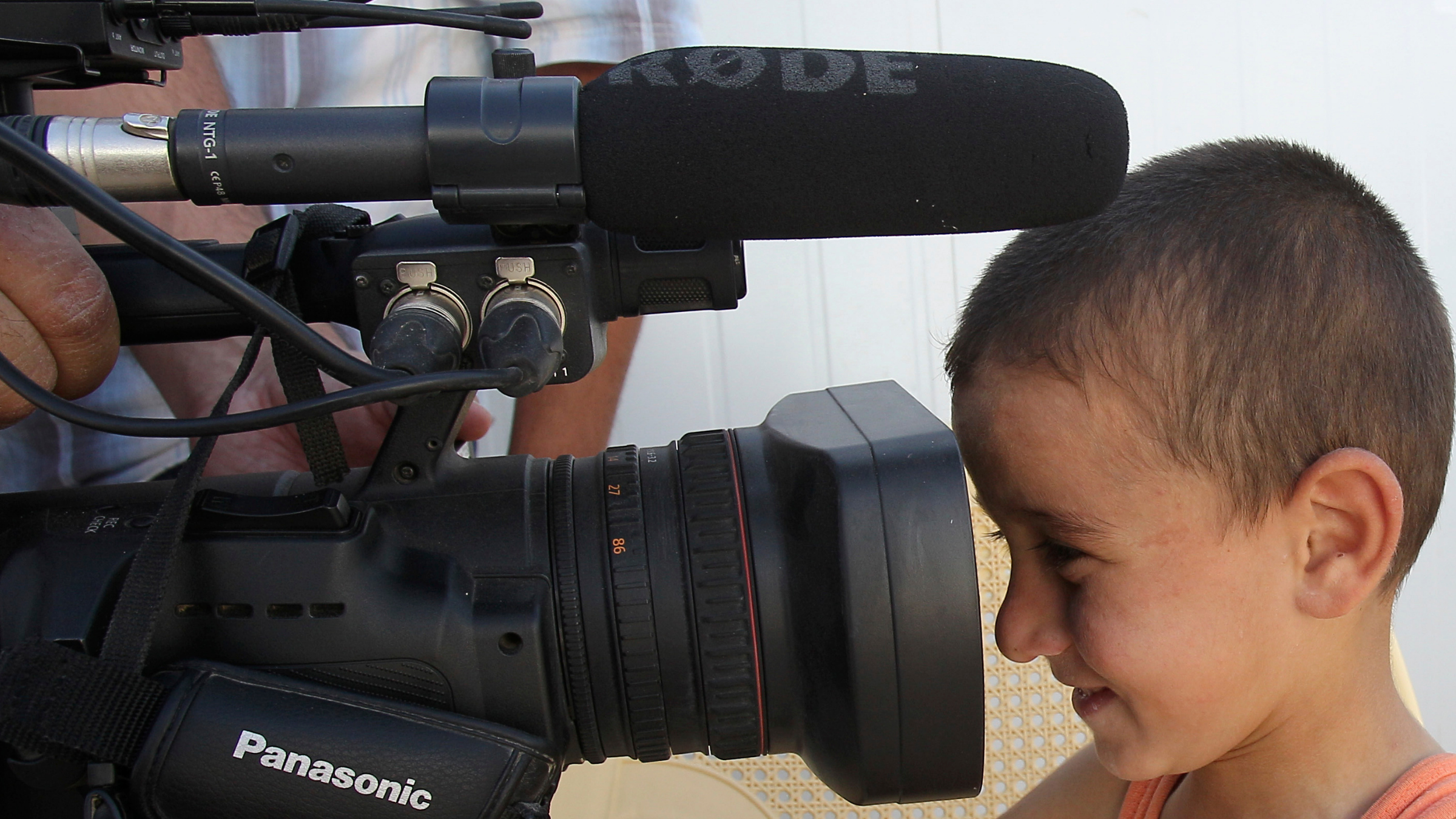 Child looking at a camera