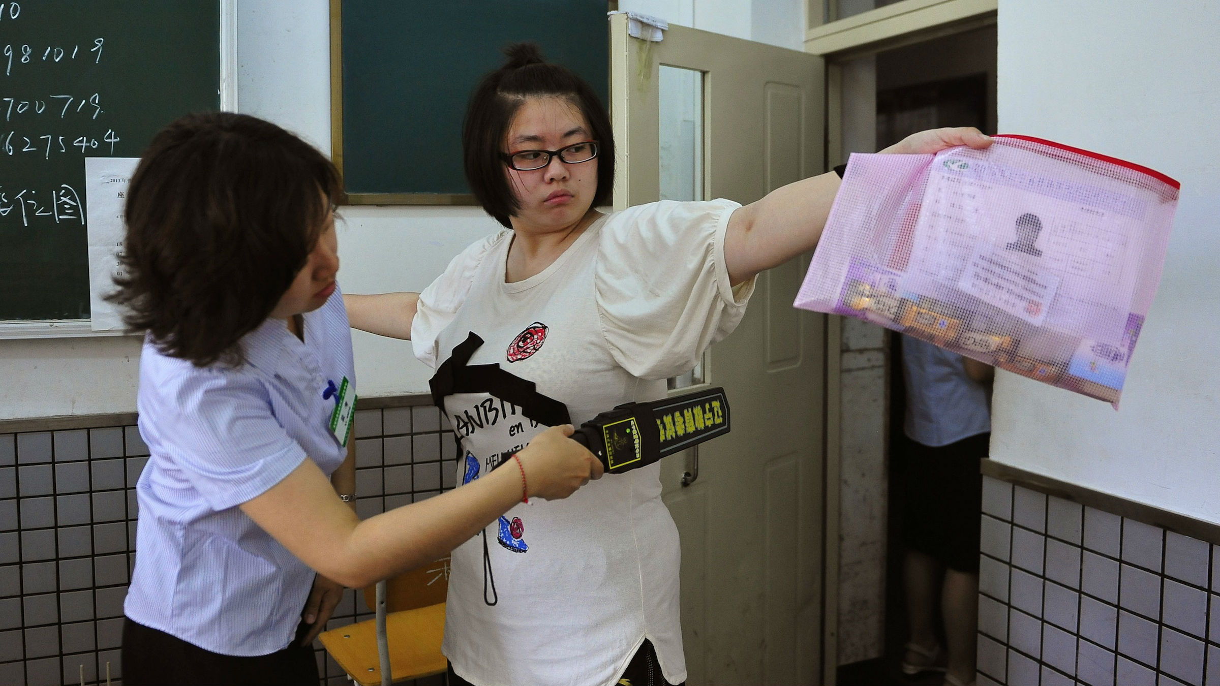 Chinese students and their parents fight for the right to
