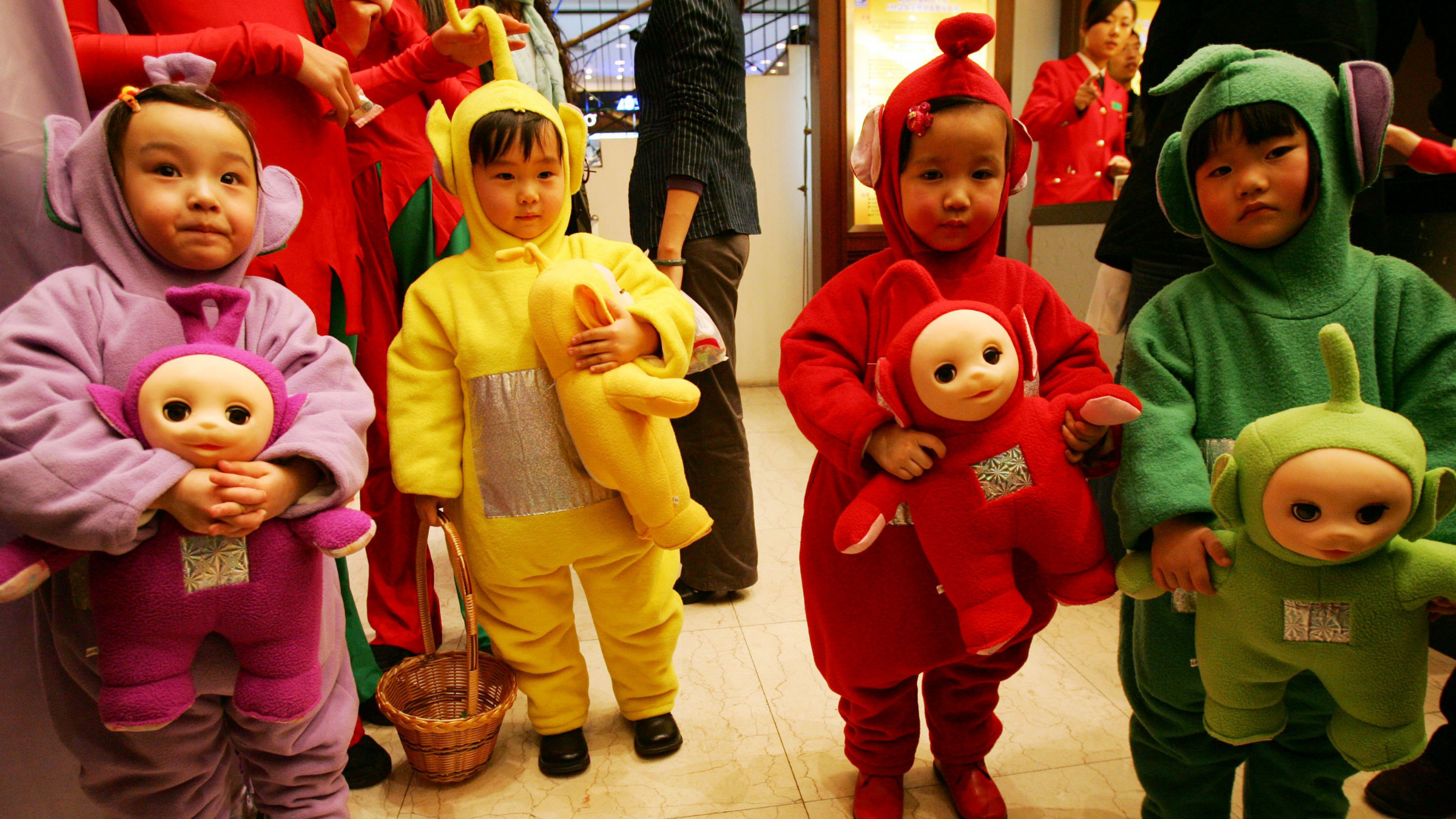Young children dressed as Teletubbies babies.