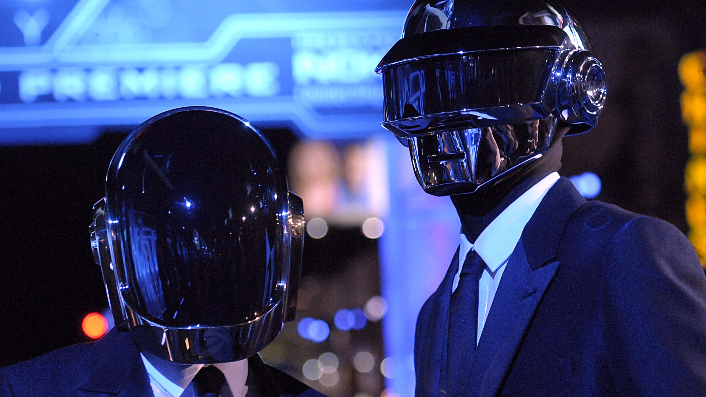 """In this Dec. 11, 2010 file photo, musician Guy-Manuel de Homem-Christo, left, and musician Thomas Bangalter of the duo Daft Punk arrive at the premiere of the feature film """"Tron: Legacy"""" in Los Angeles. Daft Punk have set a record on Spotify. The music service says the French electronic duo's song, """"Get Lucky,"""" had the biggest streaming day for a single track on Friday, April 19, 2013, in the United States and the United Kingdom. Spotify wouldn't release the number of streams."""