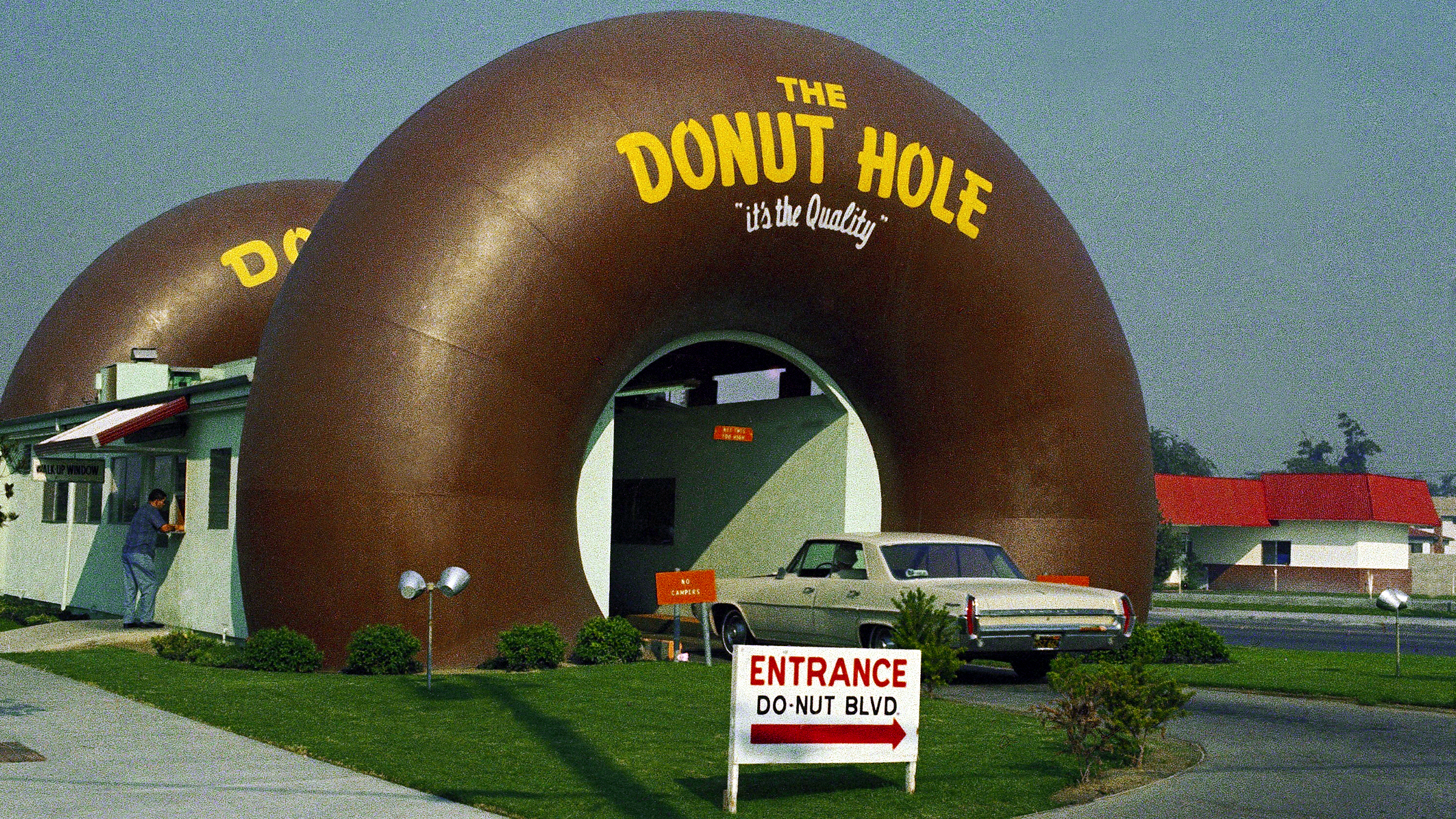 A drive-through coffee and donut shop in an eye-catching building, the Donut Hole, is shown in Los Angeles, Nov. 1970.