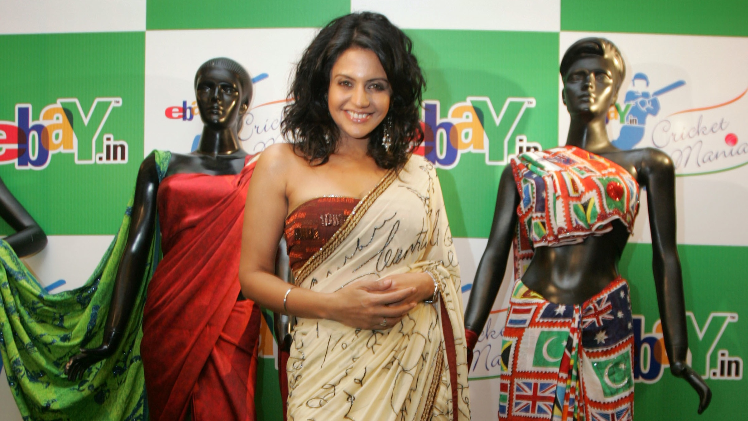 Indian cricket anchor Mandira Bedi poses with saris on the theme of the World Cup 2007 in New Delhi, India, Feb. 23, 2007. E-Bay India plans to auction collectibles as part of E-Bay Cricket Mania, ahead of next month's Cricket World Cup 2007. (AP Photo/Gurinder Osan)