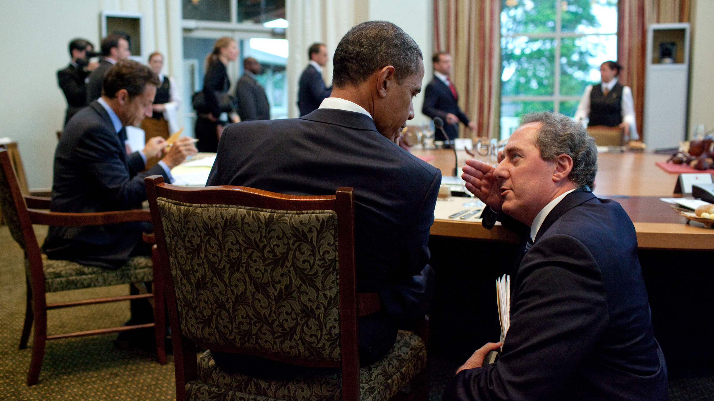 President Barack Obama talks with Michael Froman at the Working Dinner at the G8 Summit at the Deerhurst Resort in Muskoka, Canada, June 25, 2010.