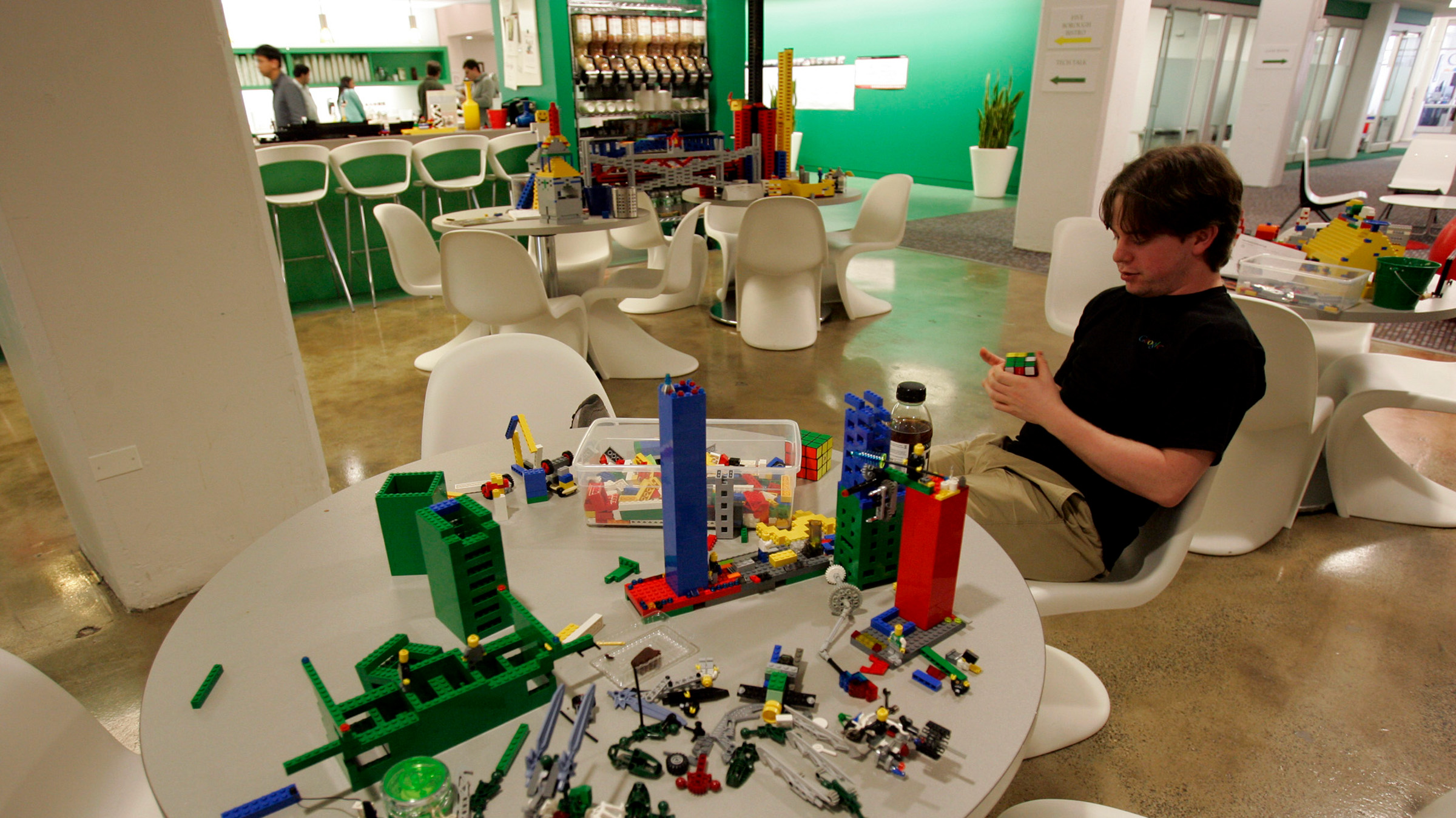 An employee plays with lego at the New York City offices of Google , March 10, 2008.