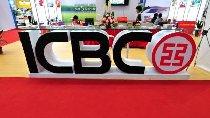 View of the stand of Industrial and Commercial Bank of China (ICBC) during an exhibition in Fuzhou, south Chinas Fujian province, 28 April 2012. The United States on Wednesday (May 9) opened its banking market to ICBC, Chinas biggest bank, for the first time clearing a takeover of a US bank by a Chinese state-controlled company. Just days after high-level US-China economic talks in Beijing, the Federal Reserve approved an application from Industrial and Commercial Bank of China to buy a majority stake in the US subsidiary of Bank of East Asia. The transaction will make ICBC the first Chinese state-controlled bank to acquire retail bank branches in the United States. ICBC has been the most aggressive of Chinas big four banks in expanding overseas. According to the Fed the bank has total assets of roughly $2.5 trillion. It will buy up to 80 percent of the US unit of the Hong Kong-based Bank of East Asia, which operates 13 branches in New York and California.(Imaginechina via AP Images