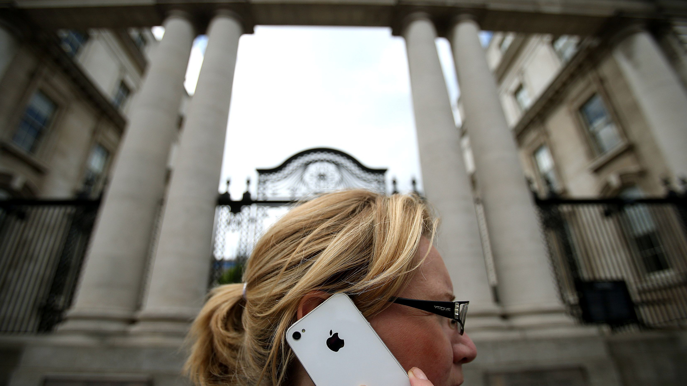 A woman on her Apple iPhone outside Government Buildings in Dublin today as Taoiseach Enda Kenny reiterated that Ireland does not negotiate specific tax deals with individual companies amid mounting criticism of Apple's corporate tax arrangements and its relationship with Ireland.