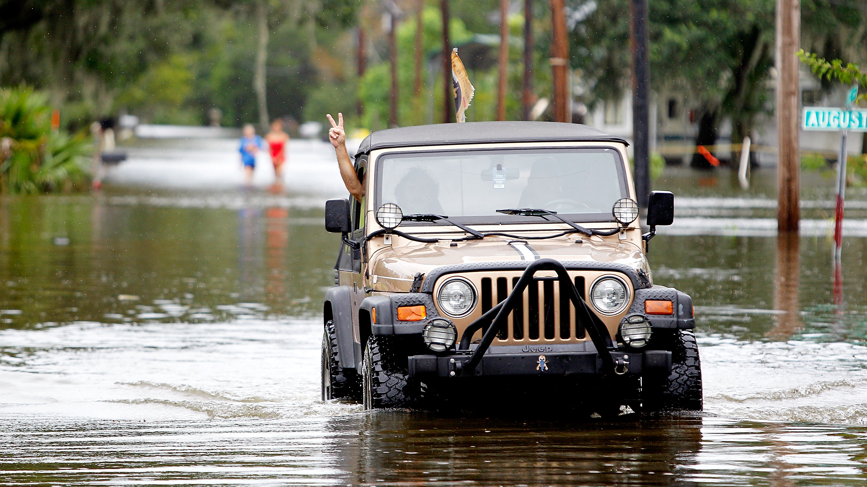 Jeep driving through water.