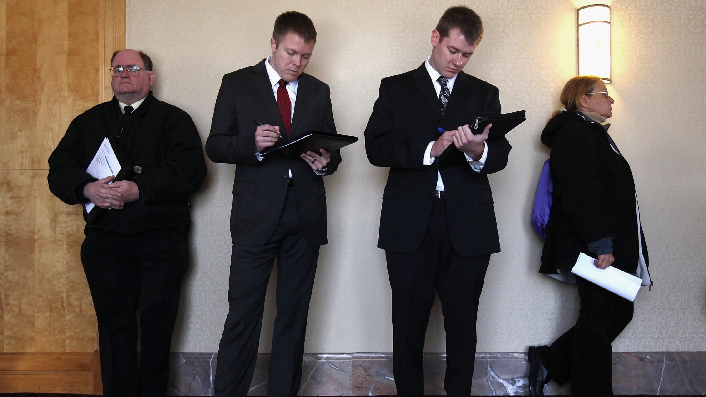 Job applicants register before entering the 'Denver Hires Job Fair'
