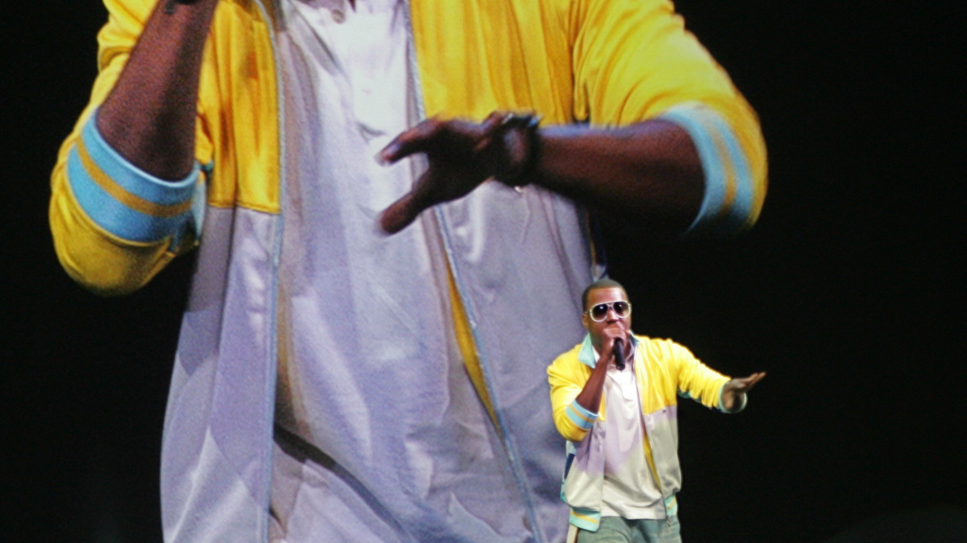 Rapper Kanye West performs at Apple Computers Inc. announcements regarding its new iPod Nano and mobile phone in San Francisco, Wednesday, Sept. 7, 2005. (AP Photo/Paul Sakuma)