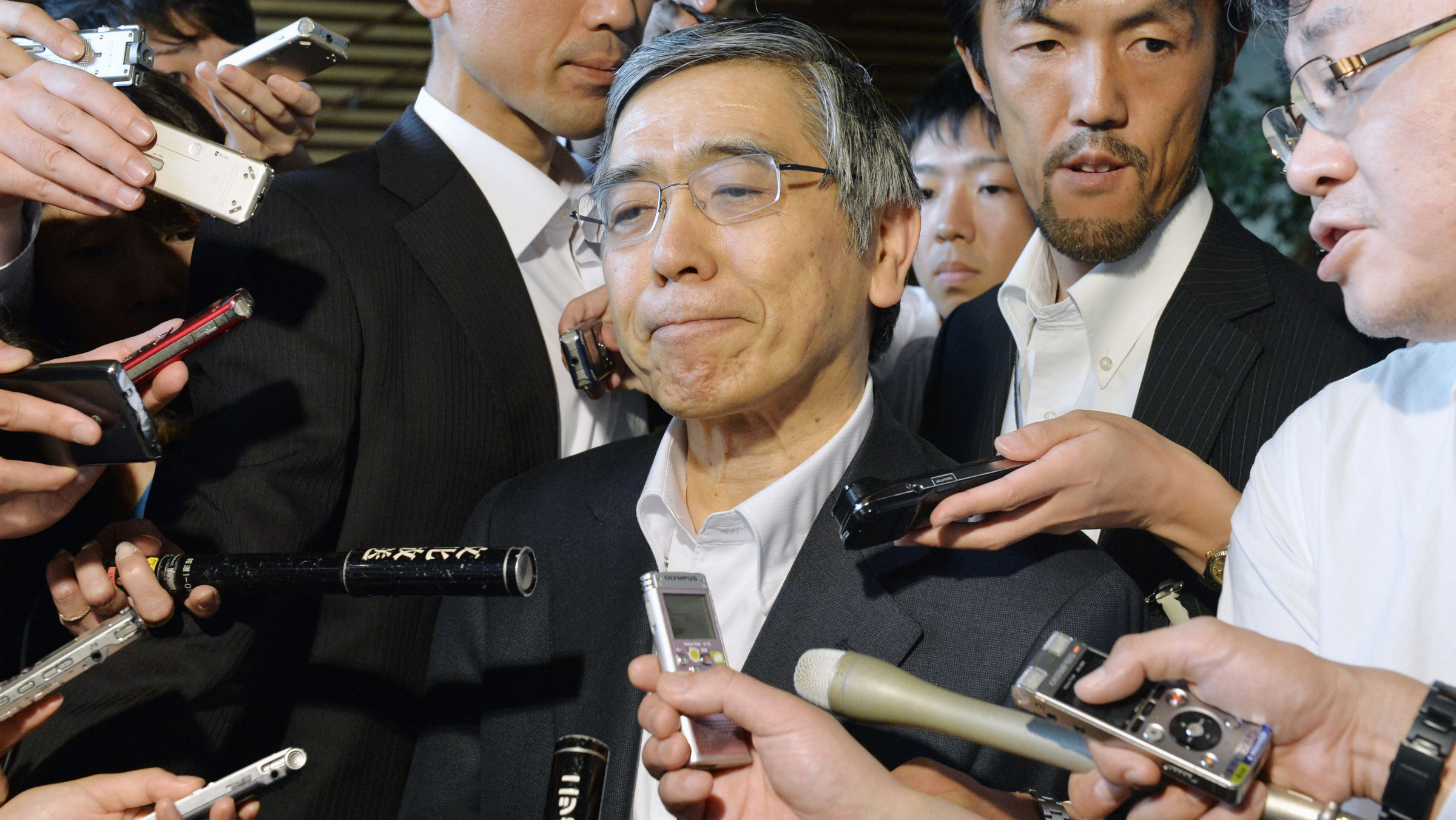 TOKYO, Japan - Bank of Japan chief Haruhiko Kuroda speaks to the press at the prime minister's office in Tokyo on June 13, 2013, after meeting with Prime Minister Shinzo Abe to discuss economic conditions and recent volatility in equity and foreign exchange markets. (Kyodo via AP Images