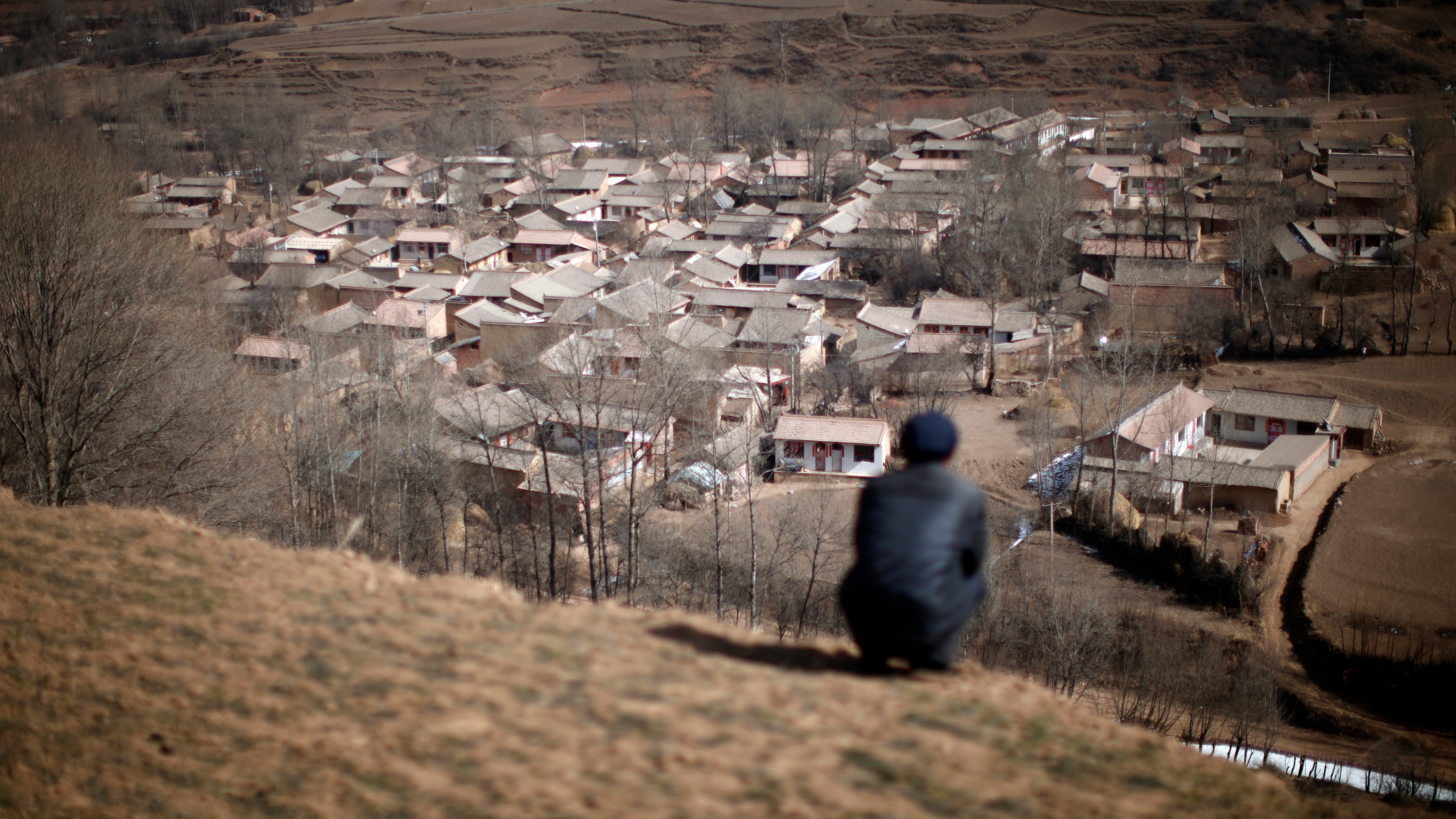 Man sitting atop hill