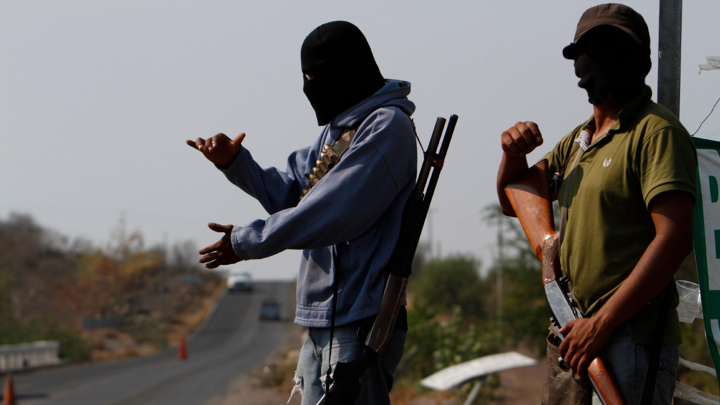 Masked and armed drug cartel members.