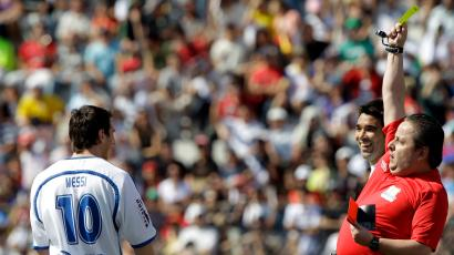 Argentina's soccer player Lionel Messi, left, is yellow carded by referee Octaviano Camargo, front right, as the Brazilian-born Portugal midfielder Anderson Luis de Souza, better known as Deco, laughs during a charity match organized by Deco in Indaiatuba, Brazil, Sunday, July 18, 2010.
