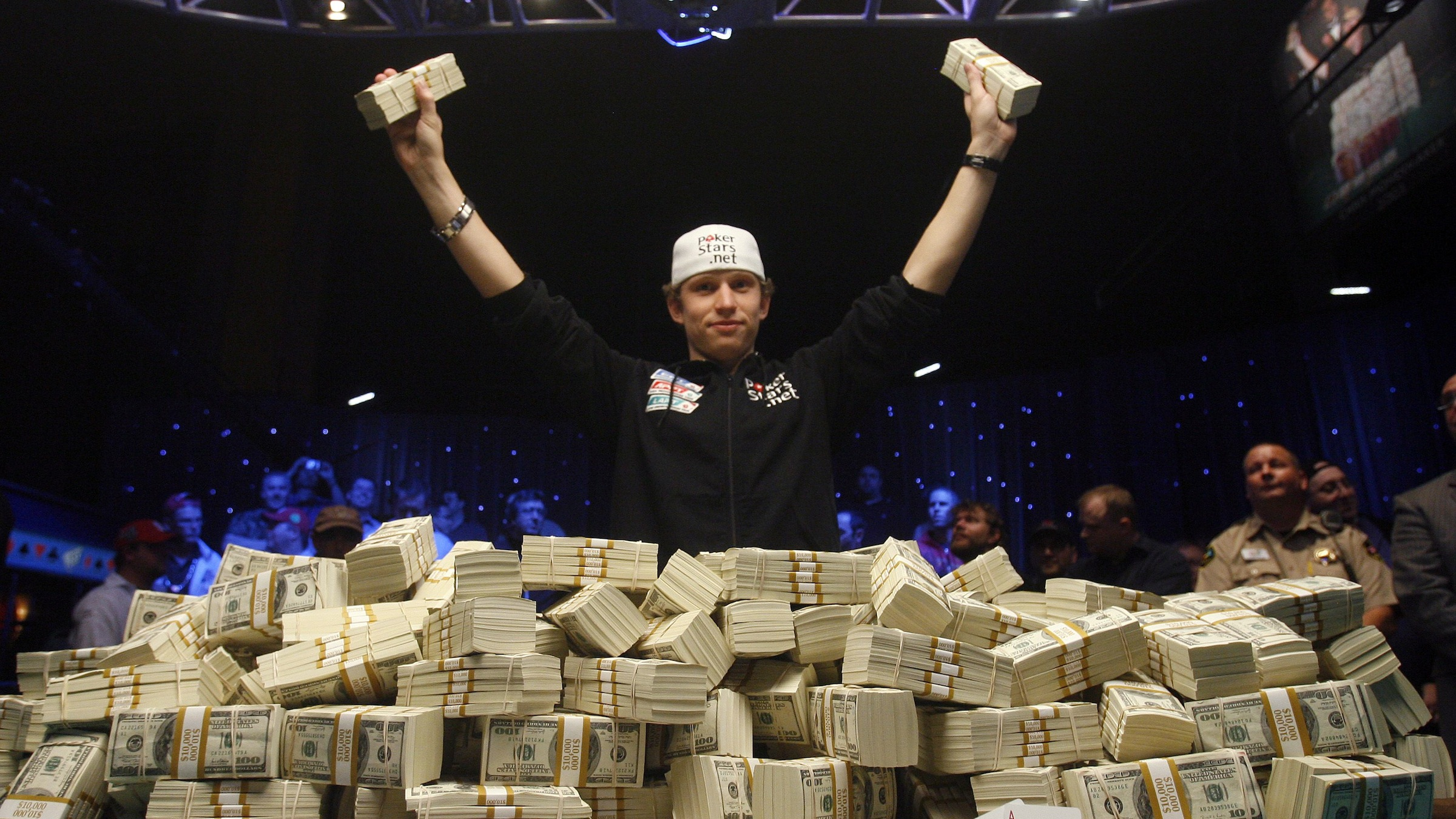 Peter Eastgate of Denmark poses with a pile of cash after winning the World Series of Poker championship in Las Vegas on Tuesday, Nov. 11, 2008. Eastgate won more than $9 million. (AP Photo/Isaac Brekken)