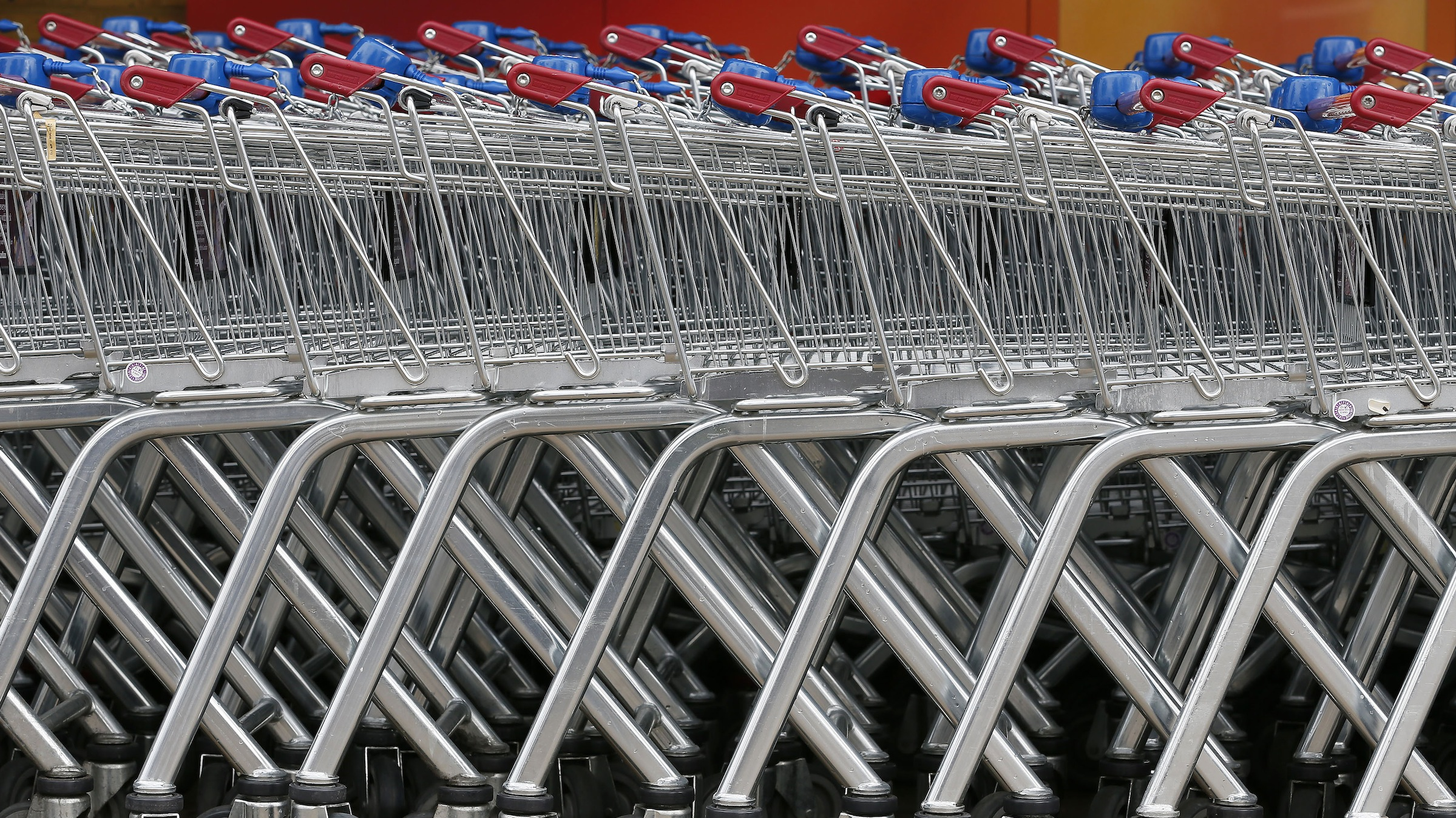 Shopping trolleys are seen parked at a Sainsbury's store in London May 8, 2013.    REUTERS/Stefan Wermuth  (BRITAIN - Tags: BUSINESS FOOD) - RTXZELW