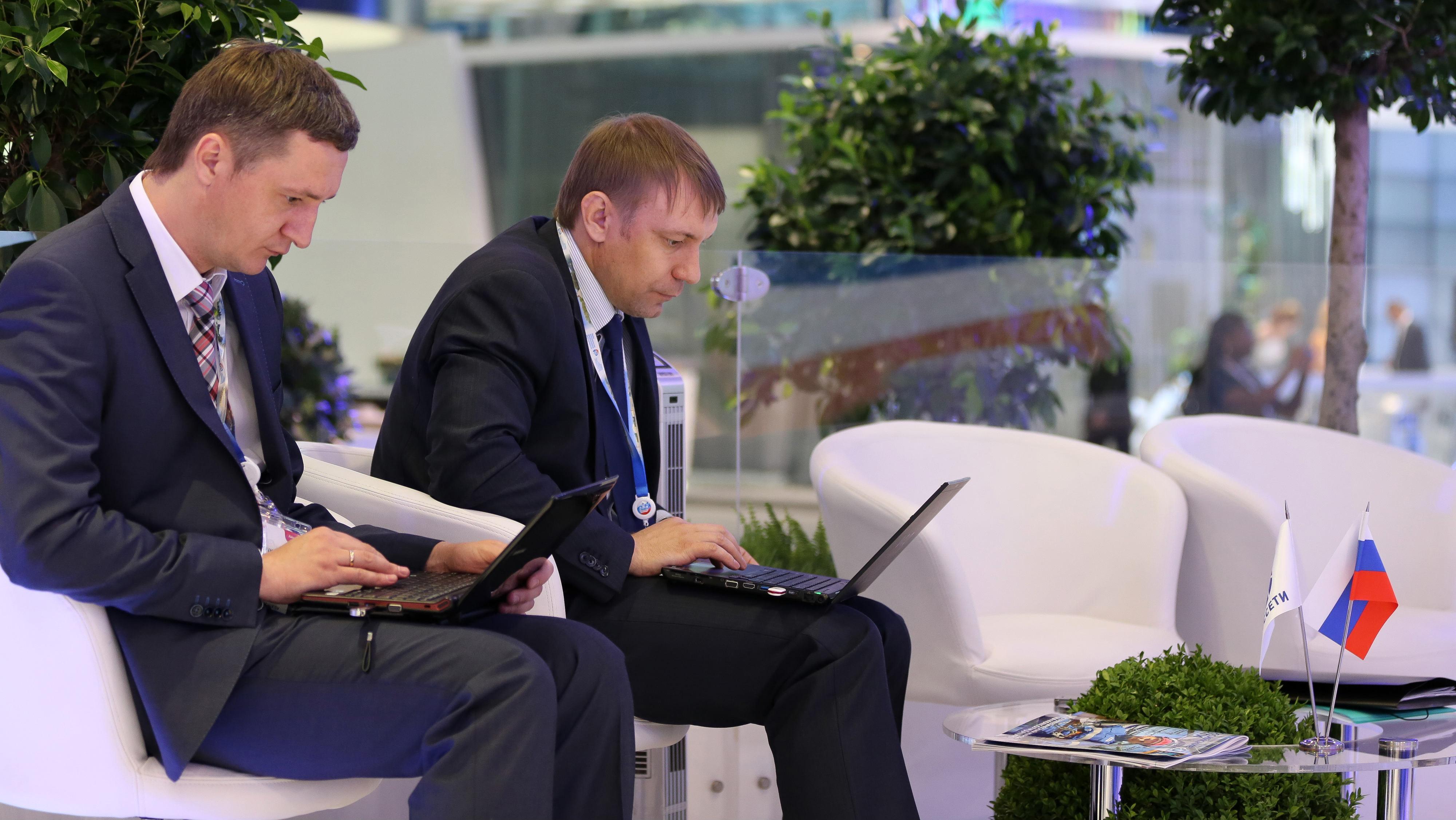 Russian men emailing