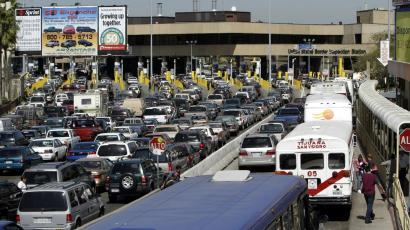 Long lines of traffic clog the San Ysidro Border Crossing waiting to enter the United States Tuesday April 5, 2005 in San Diego. Americans will need passports to re-enter the United States from Canada, Mexico, Panama and Bermuda by 2008, part of a tightening of U.S. border controls in an era of terrorist threat, three administration officials said Tuesday, April 5, 2005.