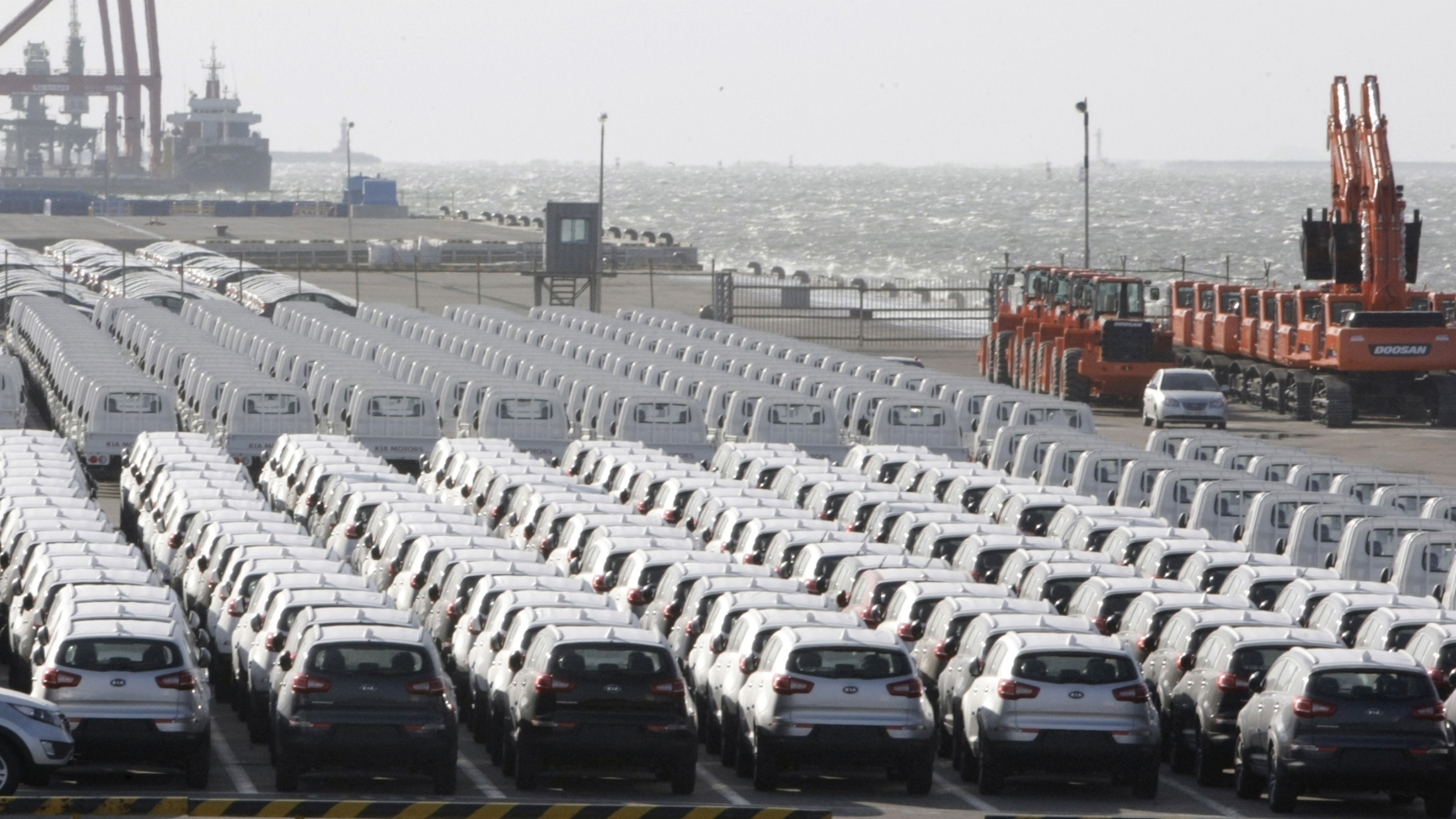 In this photo taken Monday, Oct. 25, 2010, South Korea's automobiles and heavy equipments wait to be shipped to foreign countries at a port in Gunsan, South Korea. South Korea's economic growth slowed sharply in the third quarter on weaker exports and manufacturing as prospects for the global recovery turn cloudy.(AP Photo/Ahn Young-joon