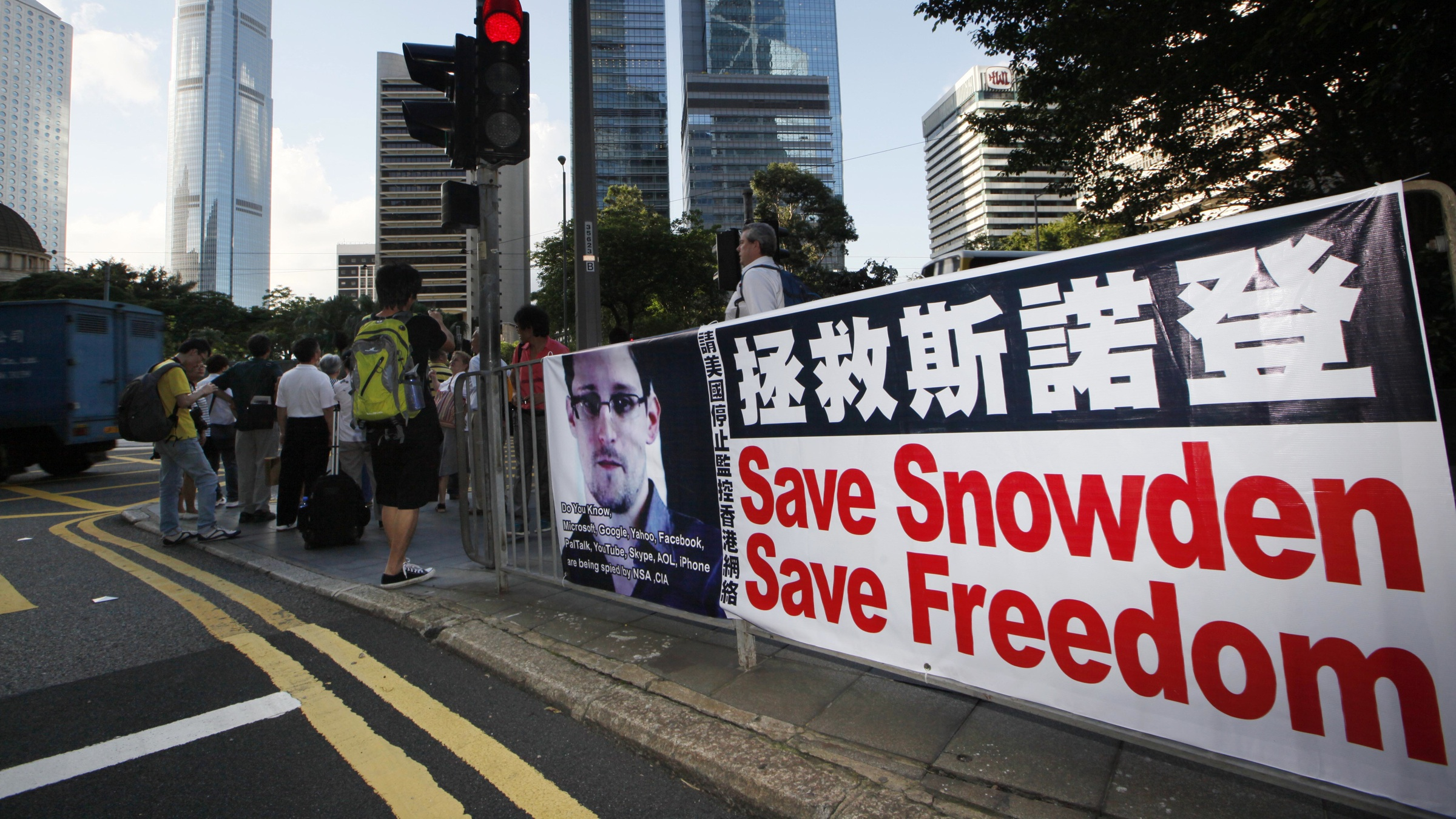 A banner supporting Edward Snowden, a former CIA employee who leaked top-secret documents about sweeping U.S. surveillance programs, is displayed at Central, Hong Kong's business district, Tuesday, June 18, 2013. President Barack Obama defended top secret National Security Agency spying programs as legal in a lengthy interview, and called them transparent — even though they are authorized in secret.  (AP Photo/Kin Cheung)