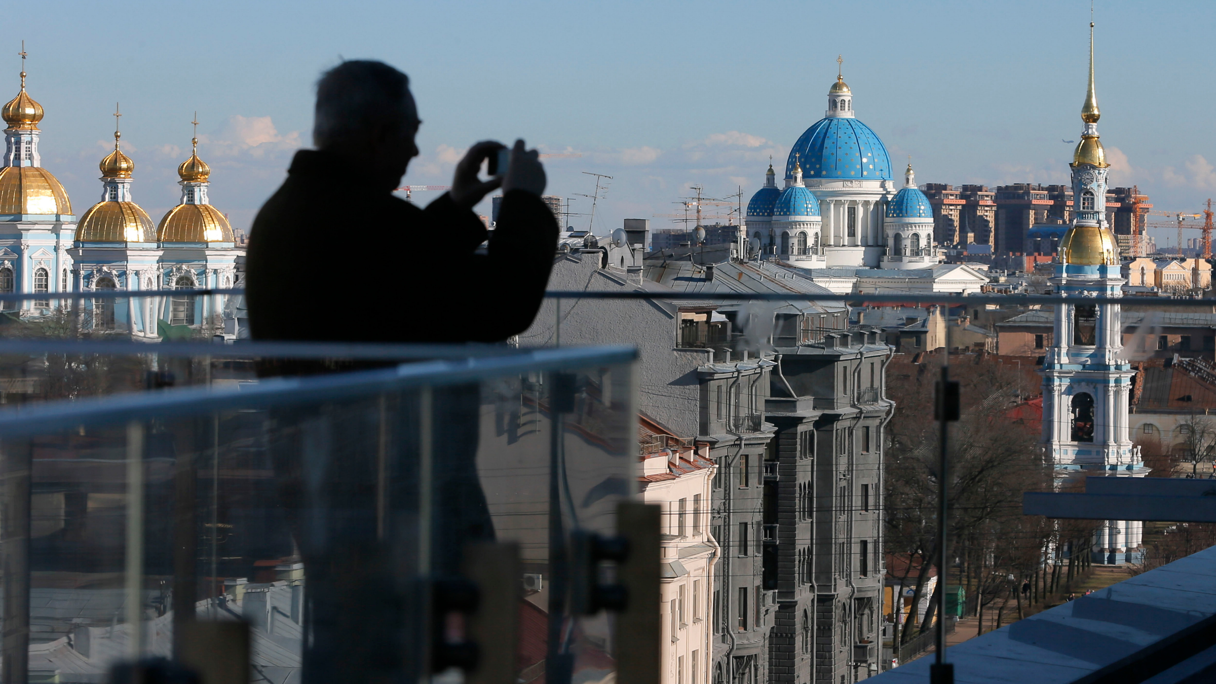 A visitor takes photos from the terrace of the new Mariinsky Theatre in St. Petersburg, Russia.