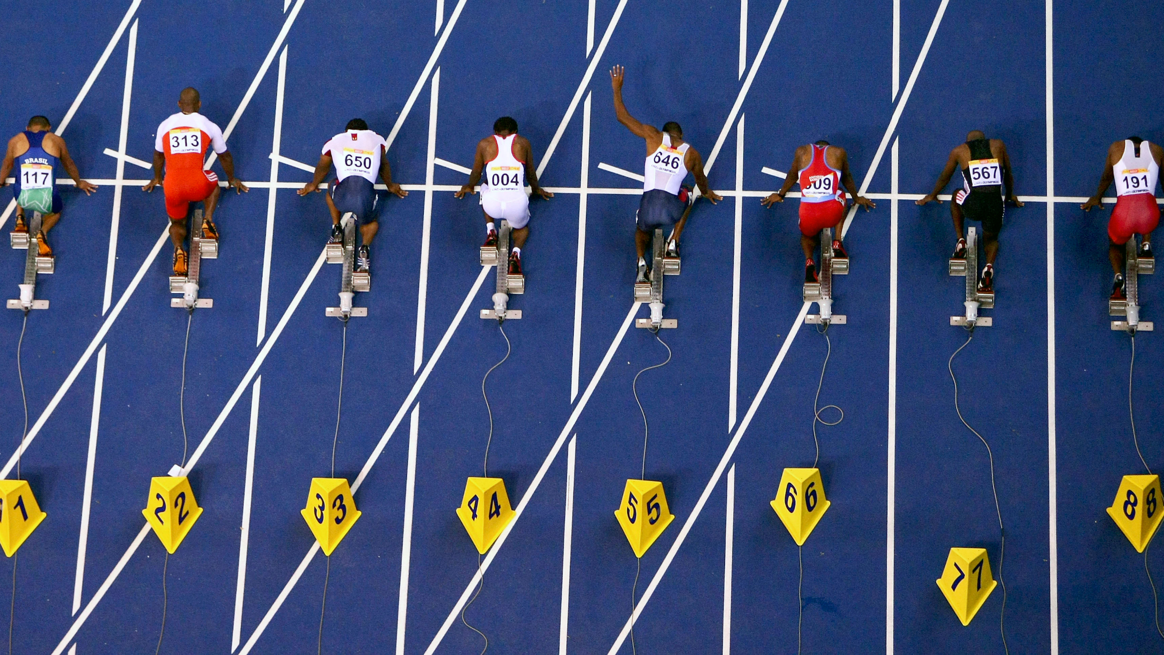 Competitors line before the start of the men's 100 metre race at the Pan American Games in Rio de Janeiro.