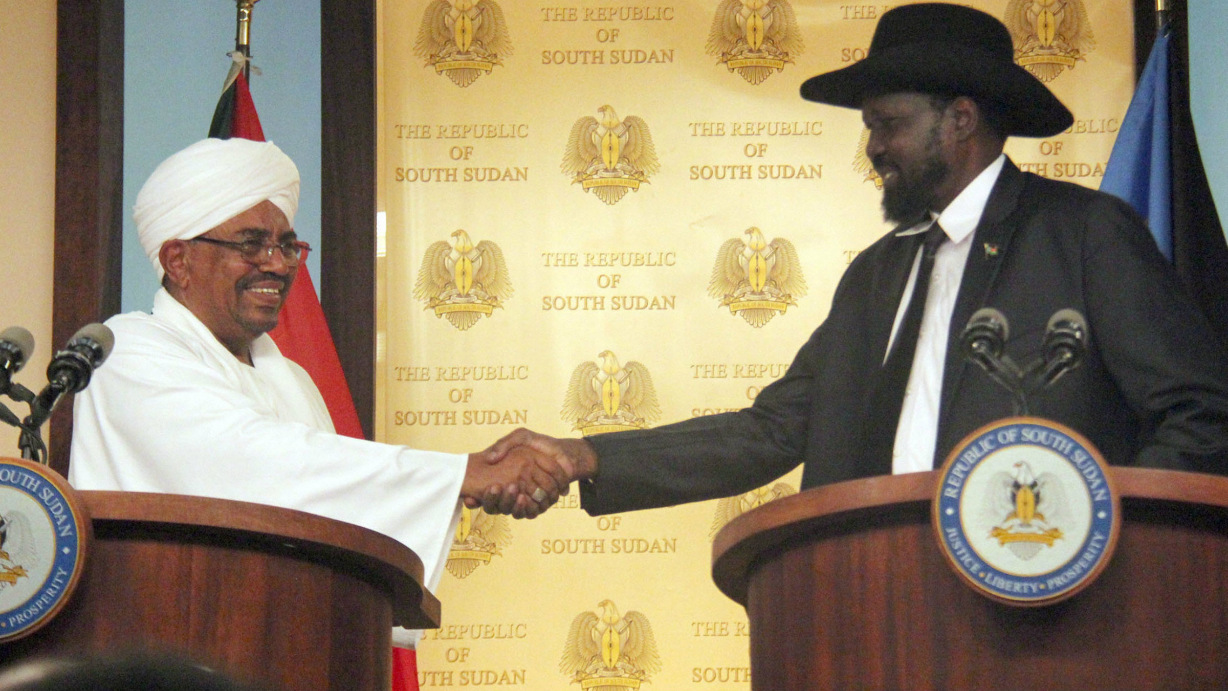 Sudan's Bashir, left, with South Sudan's Kiir, on a friendly day in April.
