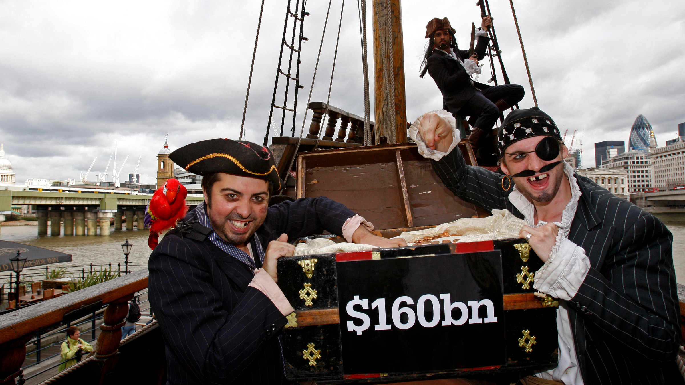 Protesters dressed up as pirates pose on a recreation of Sir Francis Drake's galleon 'Golden Hinde' to highlight the problem of tax avoidance by multinational companies ahead of the G20 Finance Ministers meeting on Sept. 4, in London, Thursday, Sept. 3, 2009.